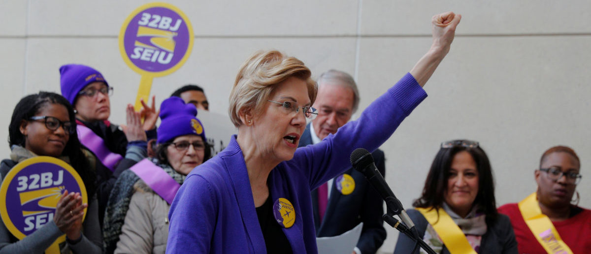 Potential 2020 Democratic presidential candidate and U.S. Senator Elizabeth Warren (D-MA) speaks about federal government employees working without pay and workers trying to unionize at Logan Airport in Boston, Massachusetts, U.S., January 21, 2019. REUTERS/Brian Snyder
