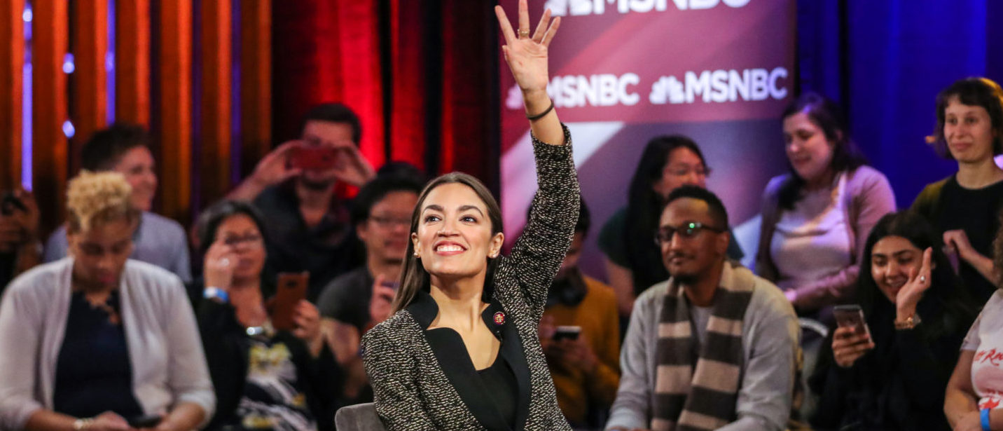 U.S. Representative Alexandria Ocasio-Cortez (D-NY) smiles to audiences following a televised town hall event on the Green New Deal in the Bronx borough of New York City, New York, U.S., March 29, 2019. REUTERS/Jeenah Moon