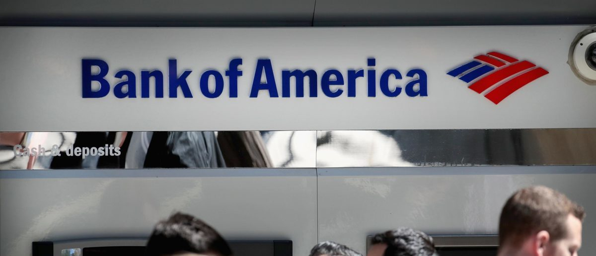 A sign hangs above an ATM machine outside of a Bank of America branch in the Loop on April 09, 2019 in Chicago, Illinois. (Photo by Scott Olson/Getty Images)