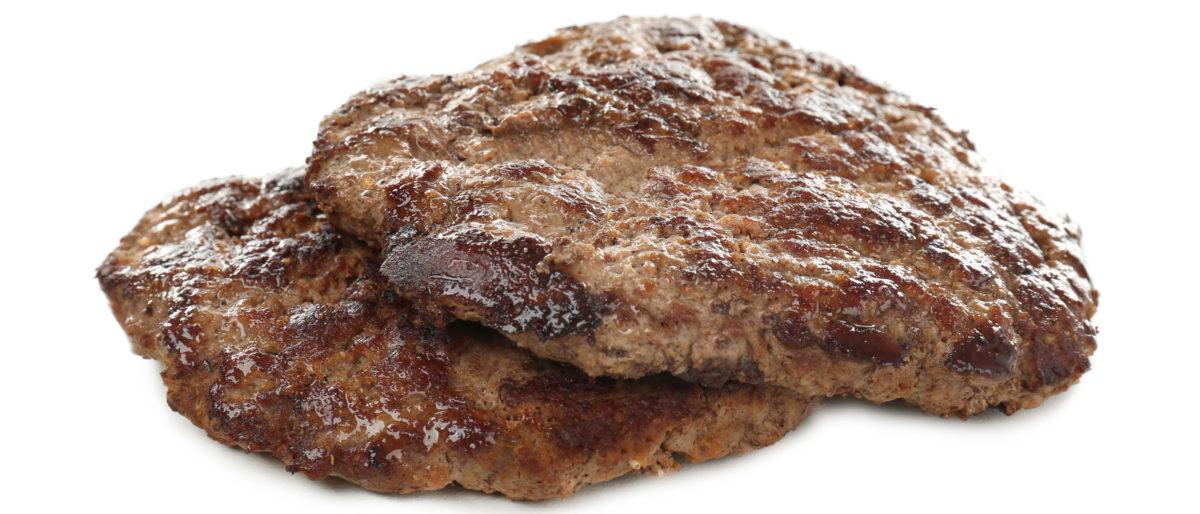 Beef patties are well-cooked. Shutterstock image via user Africa Studio