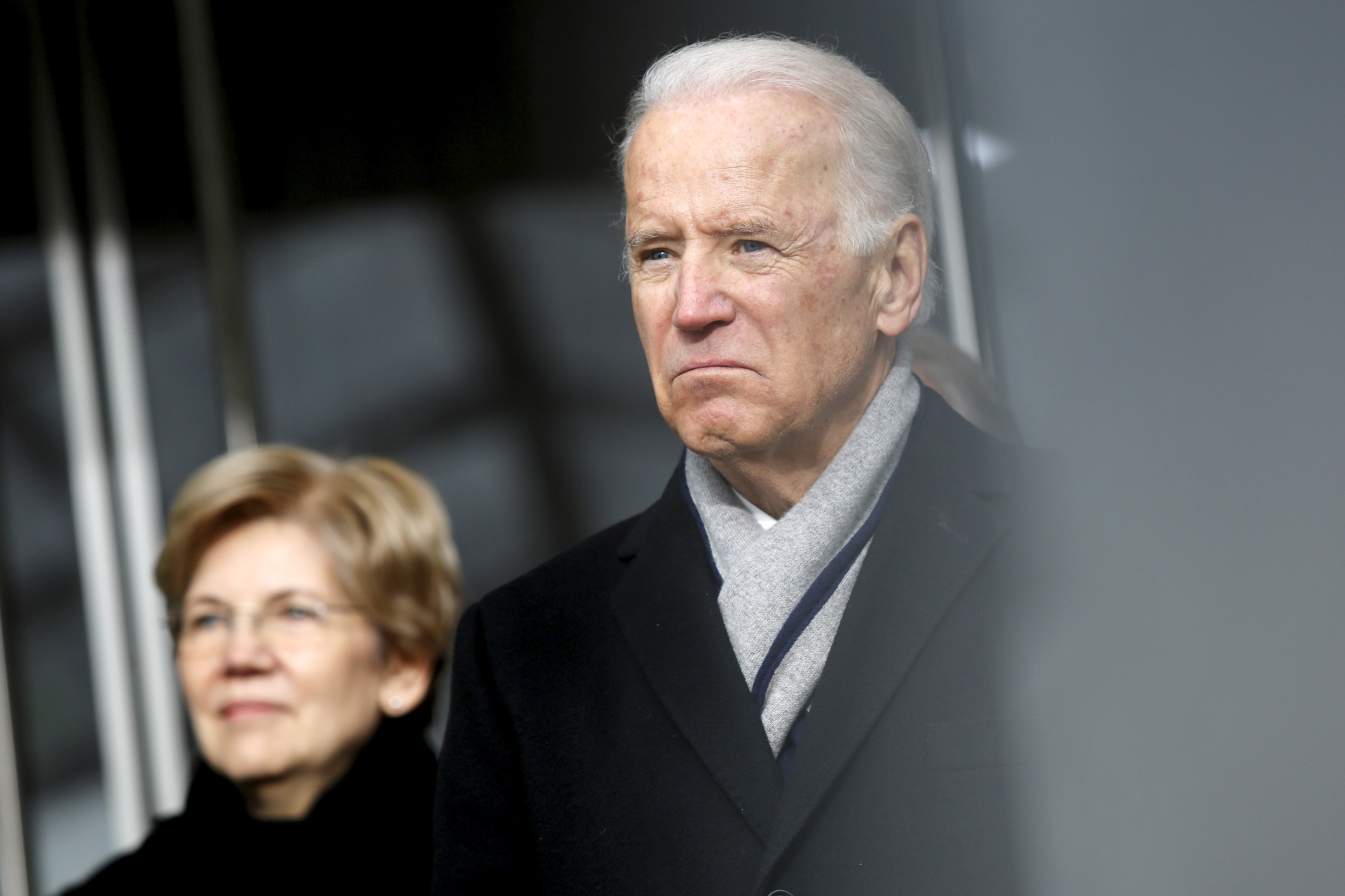 U.S. Senator Elizabeth Warren (D-MA) (L) and Vice President Joe Biden listen to remarks at the dedication ceremony for the Edward M. Kennedy Institute for the United States Senate, in Boston March 30, 2015. REUTERS/Jonathan Ernst