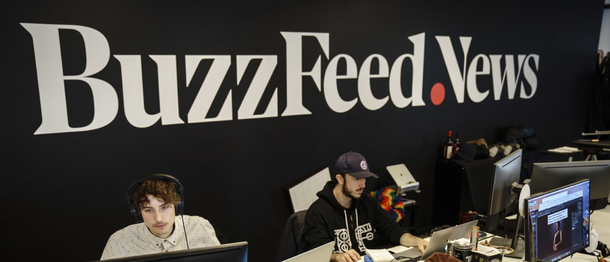 Members of the BuzzFeed News team work at their desks at BuzzFeed headquarters, December 11, 2018 in New York City (Photo by Drew Angerer/Getty Images)