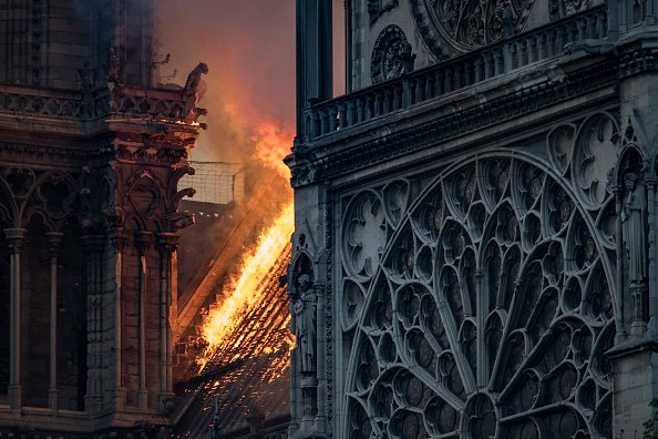 Flames and smoke are seen billowing from the roof at Notre-Dame Cathedral in Paris on April 15, 2019. (Photo by THOMAS SAMSON/AFP/Getty Images)