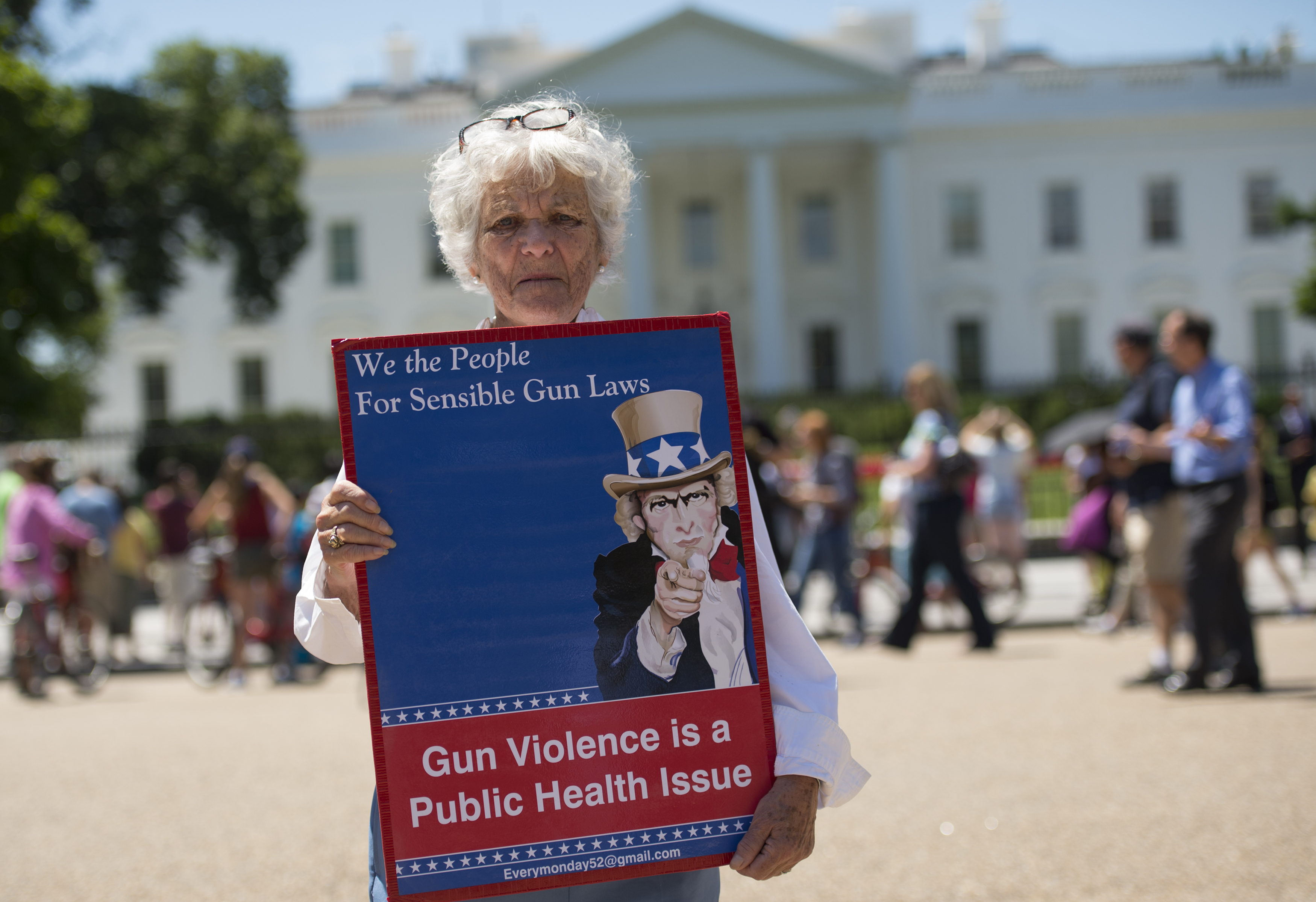 A sign to protest gun violence and call for sensible gun laws outside the White House June 13, 2016, in Washington, DC. (Photo by MOLLY RILEY/AFP/Getty Images)