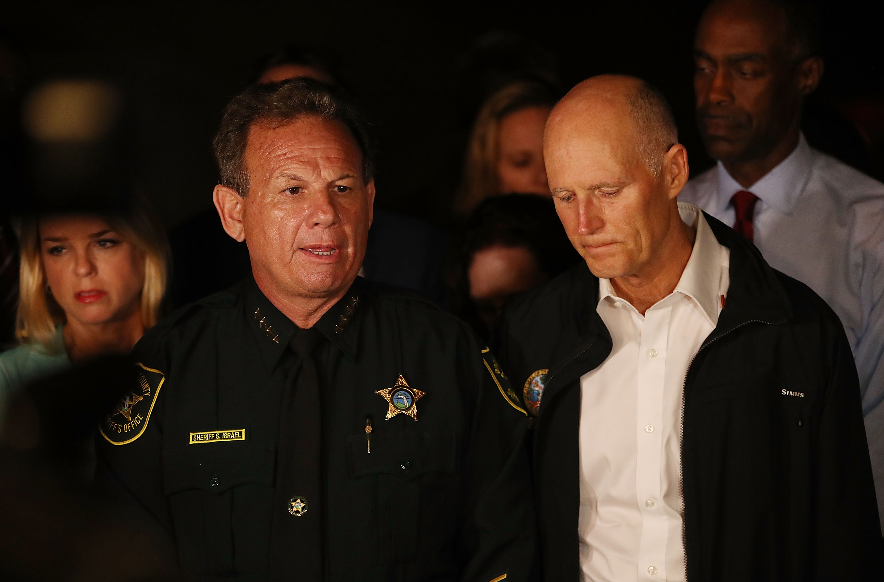 PARKLAND, FL - FEBRUARY 14: Scott Israel, Sheriff of Broward County, (L) and Florida Governor Rick Scott speak to the media as they visit Marjory Stoneman Douglas High School after a shooting at the school killed 17 people on February 14, 2018 in Parkland, Florida. Numerous law enforcement officials continue to investigate the scene. (Photo by Joe Raedle/Getty Images)