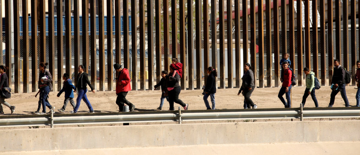 Migrants are escorted by U.S. Customs and Border Protection (CBP) officials (not pictured) after crossing illegally into the United States to request asylum, in El Paso, Texas, U.S., in this picture taken from Ciudad Juarez, Mexico, April 3, 2019. REUTERS/Jose Luis Gonzalez