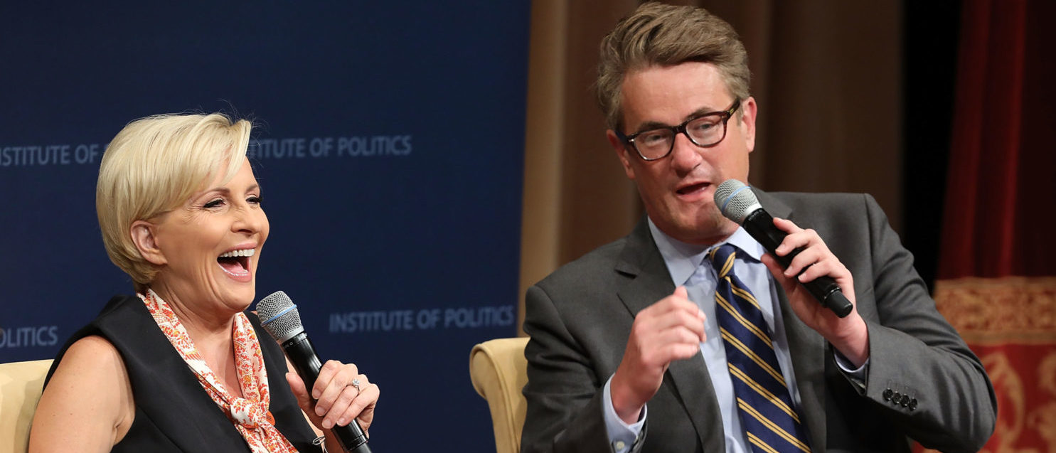 MSNBC 'Morning Joe' hosts Joe Scarborough (R) and Mika Brzezinski are interviewed by philanthropist and financier David Rubenstein during a Harvard Kennedy School Institute of Politics event in the McGowan Theater at the National Archives July 12, 2017 in Washington, DC. Chip Somodevilla/Getty Images