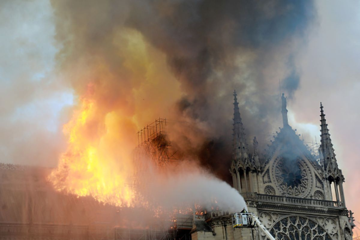 A firefighter is seen fighting the flames at Notre-Dame Cathedral April 15, 2019 in Paris, France. A fire broke out on Monday afternoon and quickly spread across the building, collapsing the spire. The cause is yet unknown but officials said it was possibly linked to ongoing renovation work. (Photo by Pierre Suu/Getty Images)