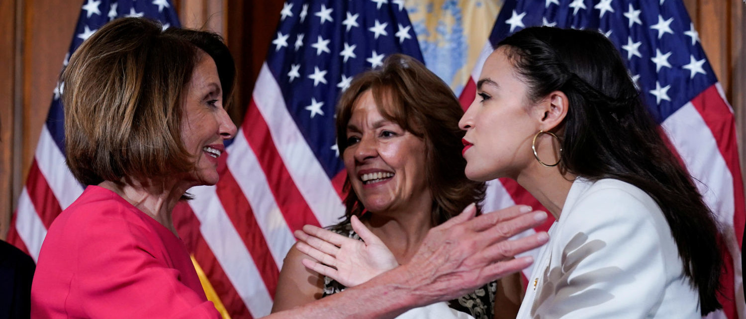 Rep. Alexandria Ocasio-Cortez (D-NY) greets Speaker of the House Nancy Pelosi (D-CA) before a ceremonial swearing-in picture on Capitol Hill in Washington, U.S., January 3, 2019. REUTERS/Joshua Roberts