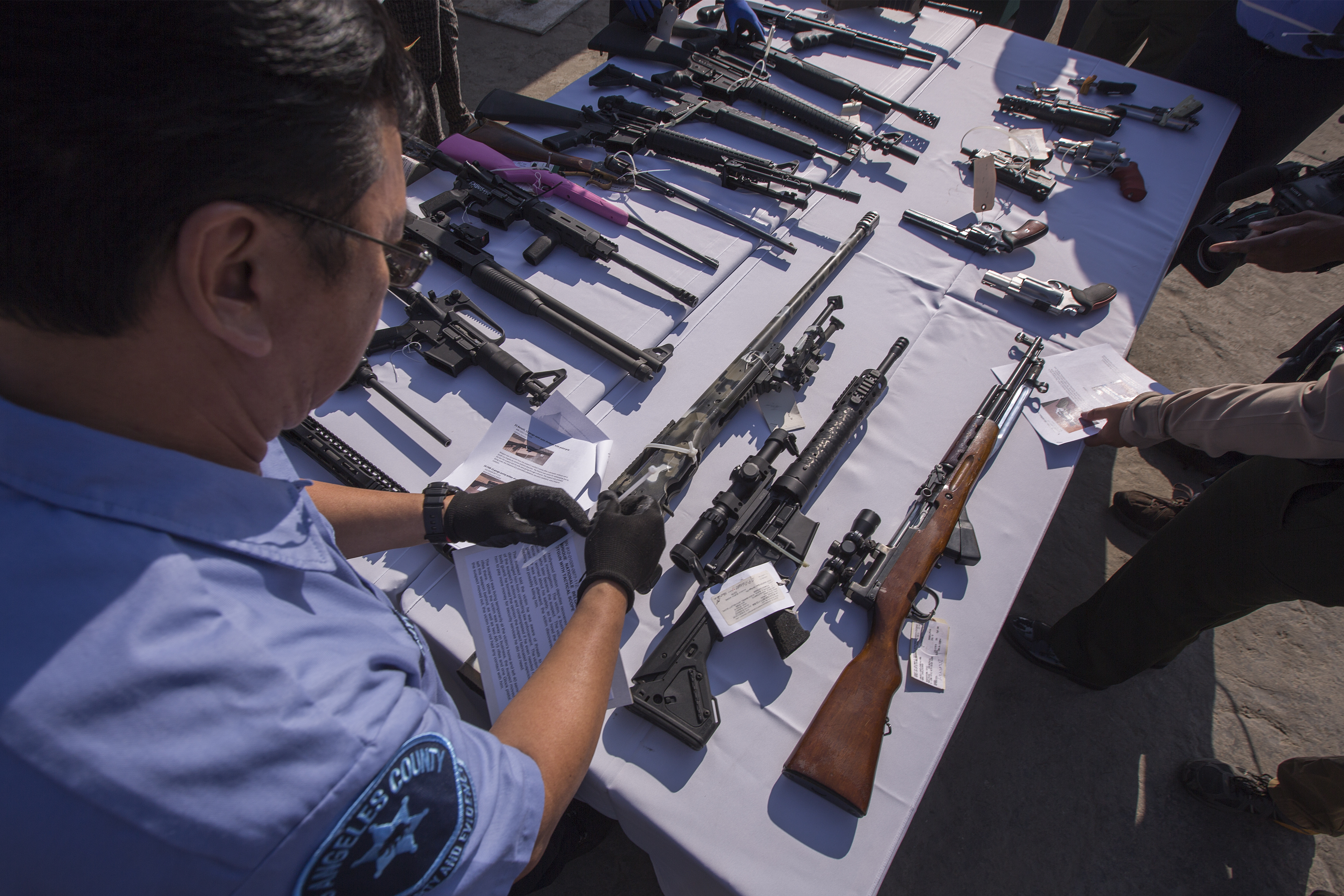 RANCHO CUCAMONGA, CA - JULY 19: Deputies handle some of approximately 3,500 confiscated guns to be melted down at Gerdau Steel Mill on July 19, 2018 in Rancho Cucamonga, California. The weapons were seized in criminal investigations, probation seizures and gun buyback events, and will be recycled into steel rebar for the construction of highways and bridges. (Photo by David McNew/Getty Images)