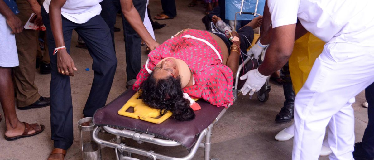 An injured Sri Lankan woman lays on a stretcher as hospital workers push her at the District General Hospital in Negombo, following an explosion at St Sebastian's Church, on April 21, 2019. (Photo credit should read STR/AFP/Getty Images)