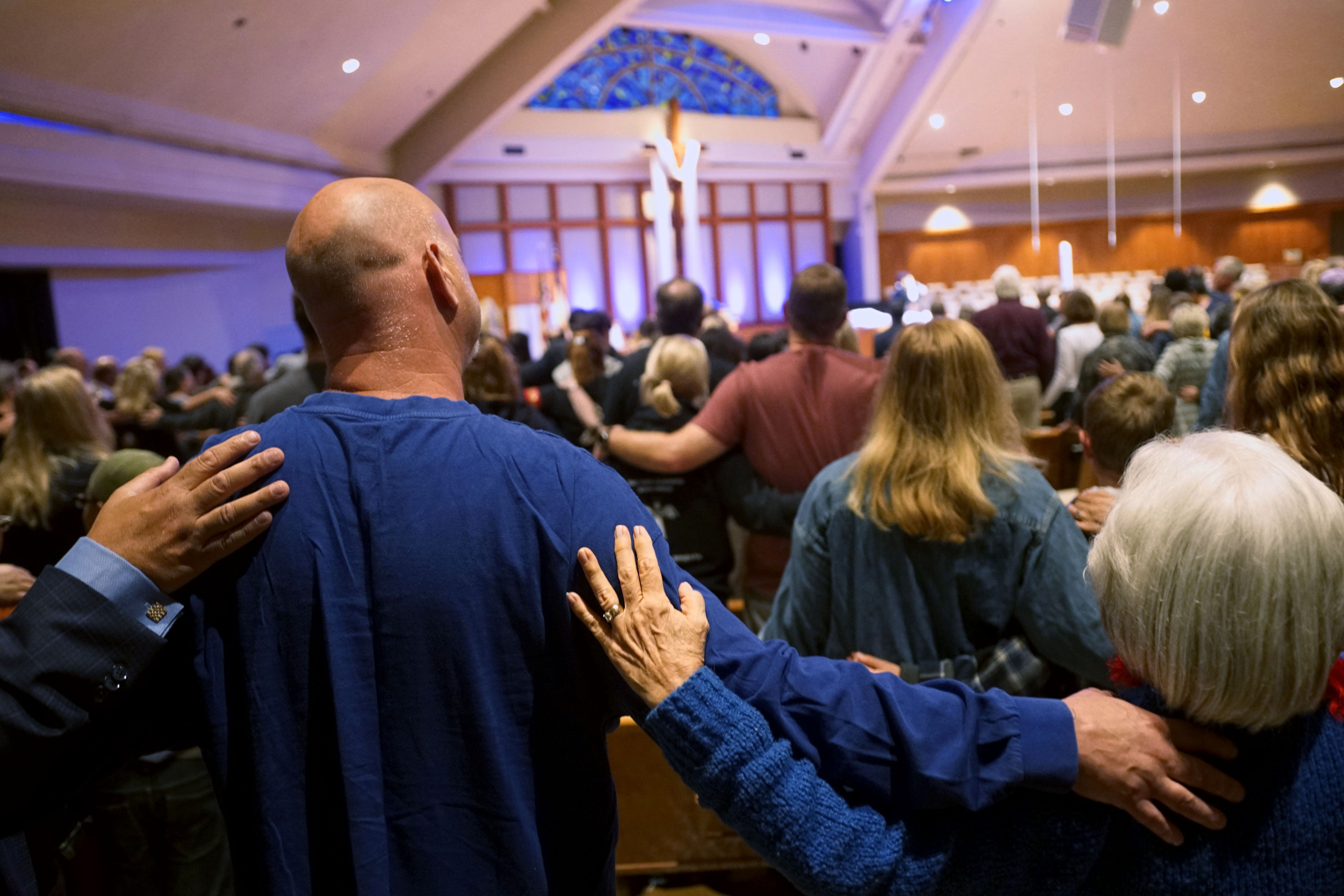 Mourners participate in a vigil for the victims of the Chabad of Poway Synagogue shooting at the Rancho Bernardo Community Presbyterian Church on April 27, 2019 in Poway, California. - A teenage gunman who wrote a hate-filled manifesto opened fire at a synagogue in California on April 27, killing one person and injuring three others including the rabbi as worshippers marked the final day of Passover, authorities said. (Photo by SANDY HUFFAKER / AFP) (Photo credit should read SANDY HUFFAKER/AFP/Getty Images)