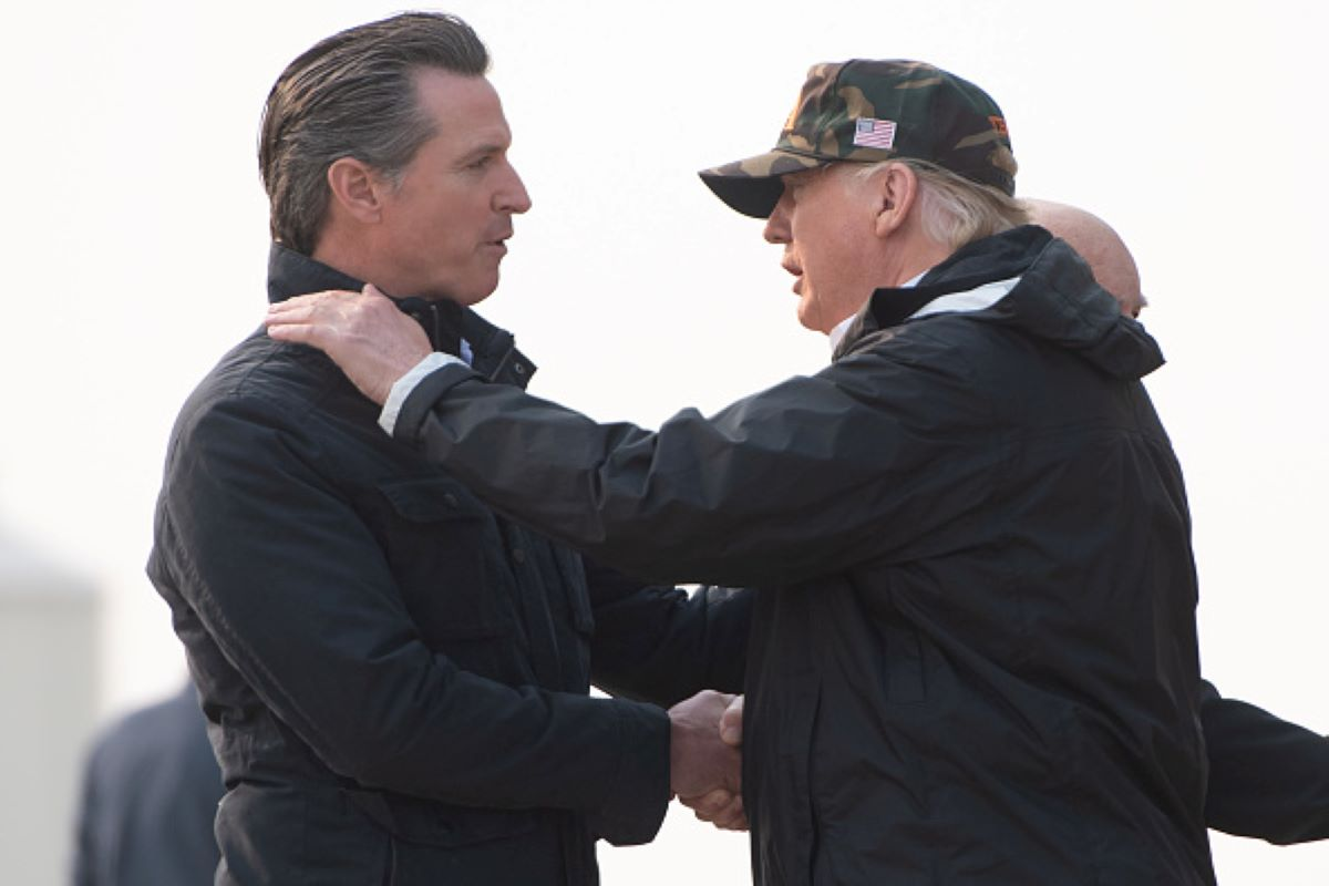 US President Donald Trump greets California Governor-elect Gavin Newsom (L) as he disembarks from Air Force One upon arrival at Beale Air Force Base in California, November 17, 2018, as he travels to view wildfire damage. (Photo by SAUL LOEB / AFP) (Photo credit should read SAUL LOEB/AFP/Getty Images)