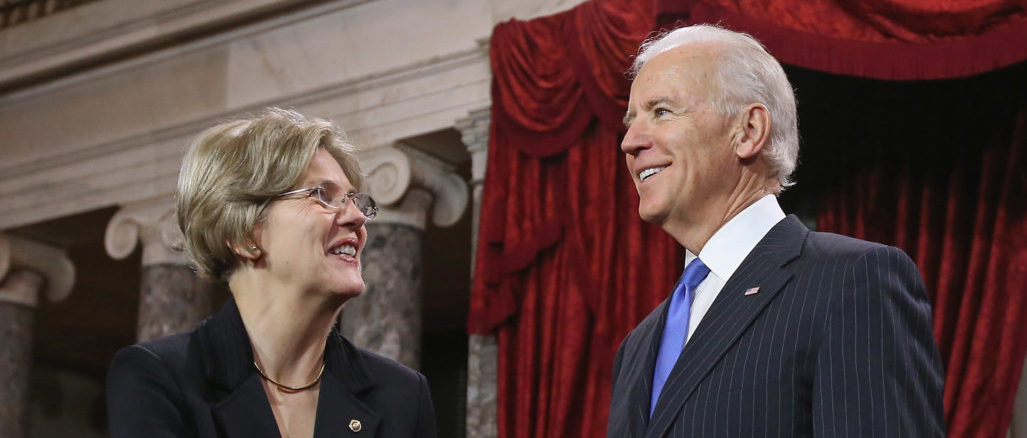 U.S. Sen. Elizabeth Warren (D-MA) (L) participates in a reenacted swearing-in with U.S. Vice President Joe Biden in the Old Senate Chamber at the U.S. Capitol January 3, 2013 in Washington, DC. Biden swore in the newly-elected and re-elected senators earlier in the day on the floor of the current Senate chamber. Somodevilla/Getty Images