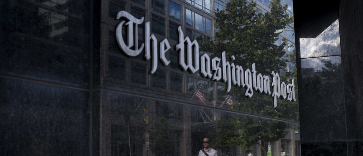 A man walks past The Washington Post on August 5, 2013 in Washington, DC after it was announced that Amazon.com founder and CEO Jeff Bezos had agreed to purchase the Post for $250 million. (BRENDAN SMIALOWSKI/AFP/Getty Images)