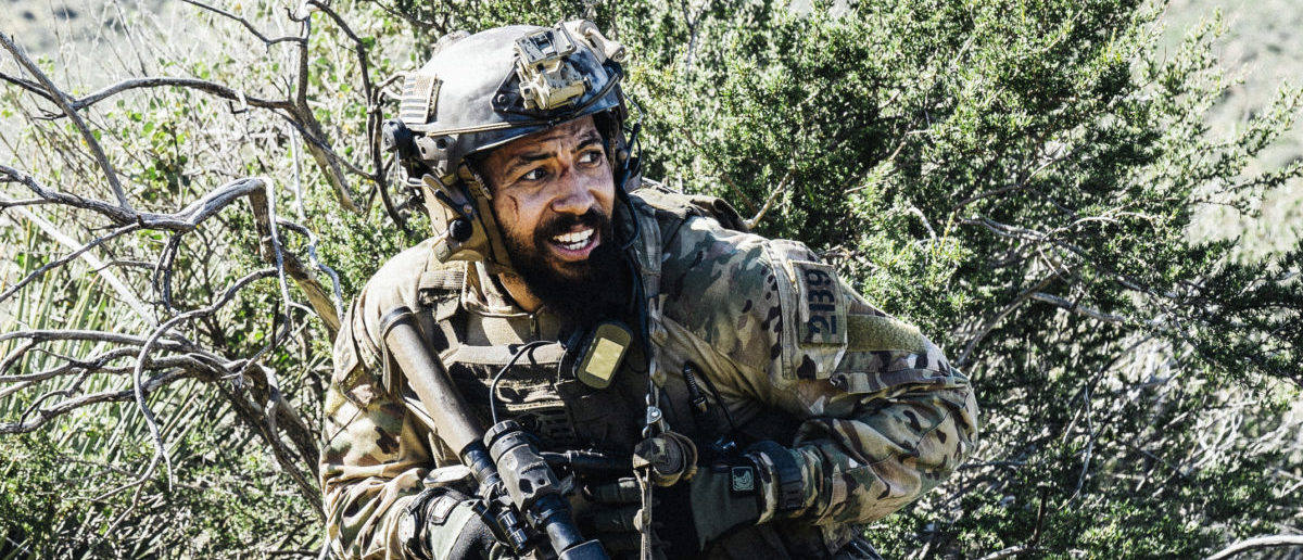 """""""Bravo Team desperately searches for Ray after he gets separated from them while in enemy territory, on SEAL TEAM, Wednesday, May 8 (10:00-11:00 PM, ET/PT) on the CBS Television Network. Series star David Boreanaz directed the episode. Pictured: Neil brown Jr. as Ray Perry. Photo: Erik Voake/CBS ©2019 CBS Broadcasting, Inc. All Rights Reserved"""