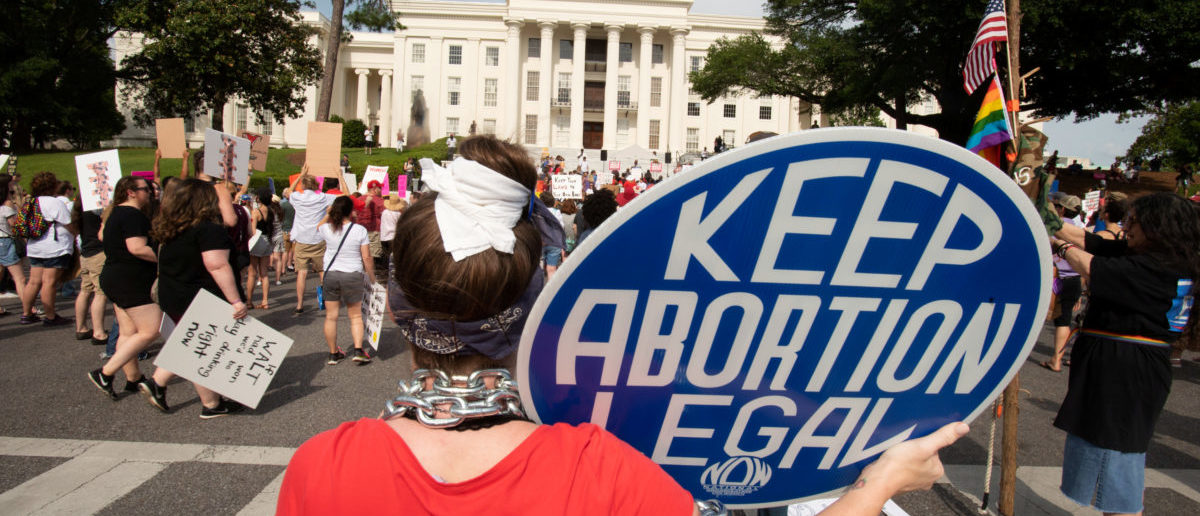 People listen at the Alabama State Capitol during the March for Reproductive Freedom against the state's new abortion law, the Alabama Human Life Protection Act, in Montgomery, Alabama, U.S. May 19, 2019. REUTERS/Michael Spooneybarger