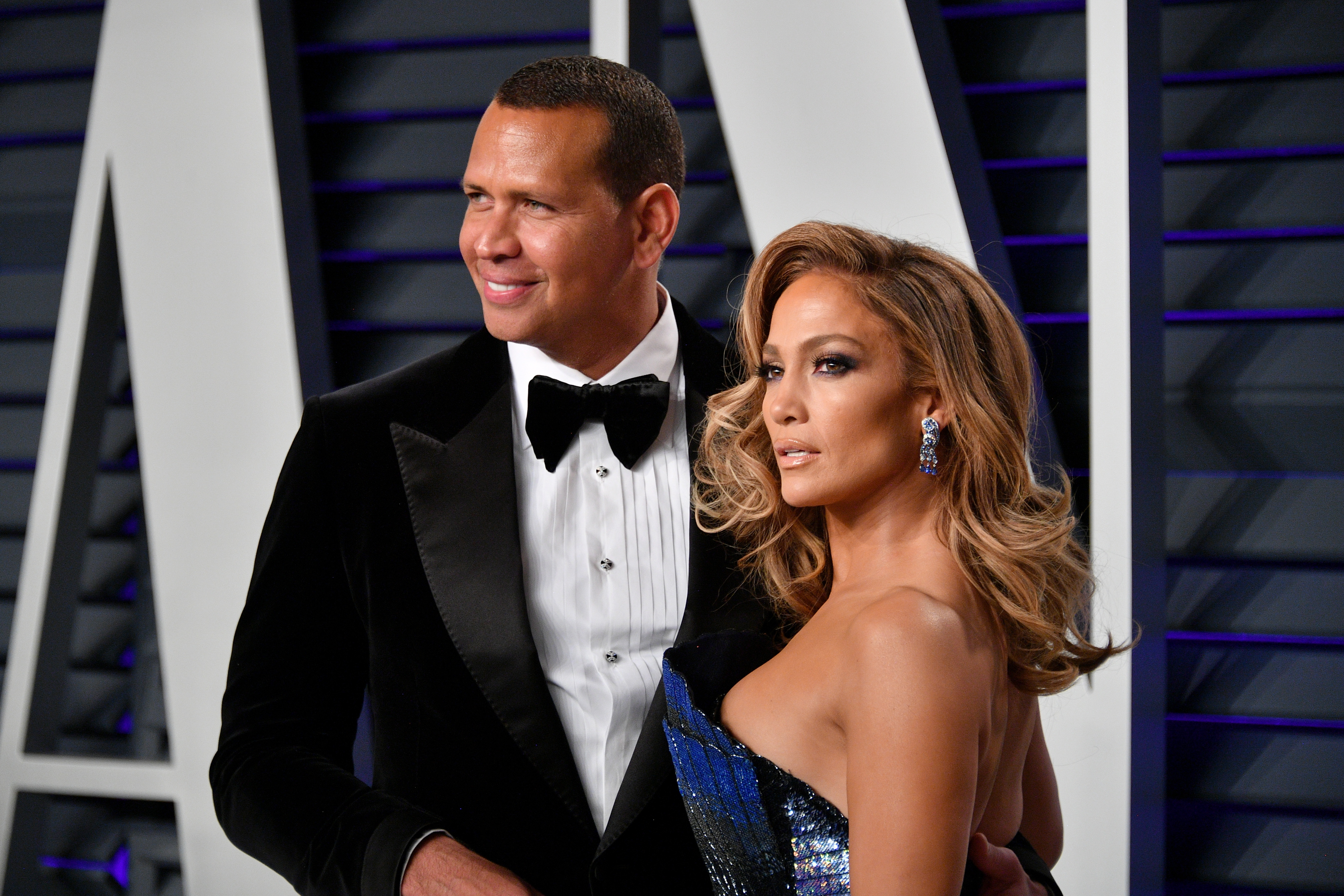 Alex Rodriguez (L) and Jennifer Lopez attend the 2019 Vanity Fair Oscar Party hosted by Radhika Jones at Wallis Annenberg Center for the Performing Arts on February 24, 2019 in Beverly Hills, California. (Photo by Dia Dipasupil/Getty Images)