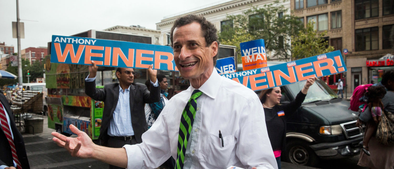 NEW YORK, NY - SEPTEMBER 10: New York City mayoral hopeful Anthony Weiner meets with people on a street corner In Harlem on September 10, 2013 in New York City. Registered voters in New York are voting today in the Democratic and Republican primary races to nominate party candidates for the New York mayoral race. (Photo by Andrew Burton/Getty Images)