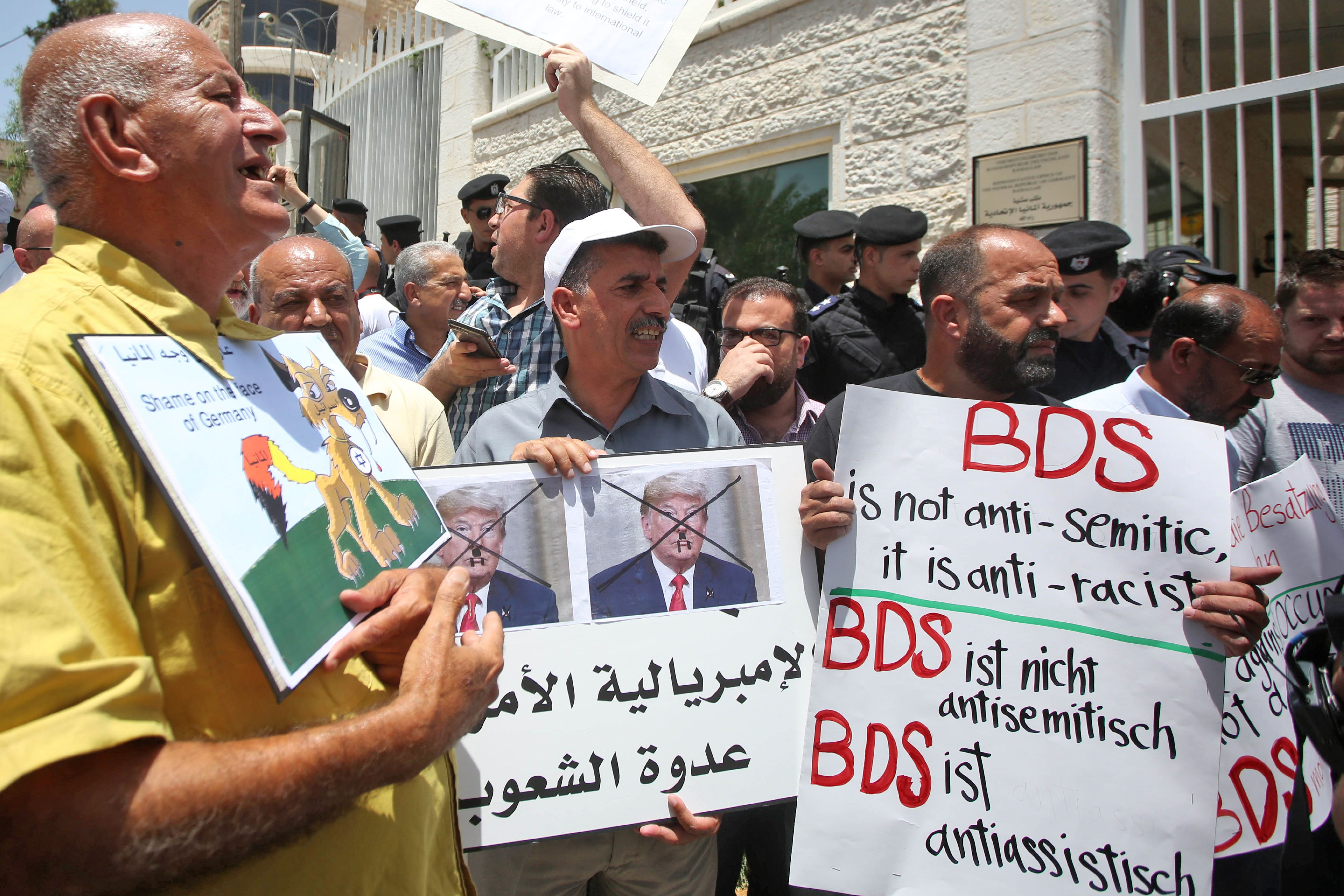 Protesters stage a demonstration outside Germany's Representative Office in Ramallah in the Palestinian West Bank on May 22, 2019, following the Bundestag's (German parliament) condemnation of the Boycott, Divestment, Sanctions (BDS) movement as anti-Semitic. (AFP/Getty Images)