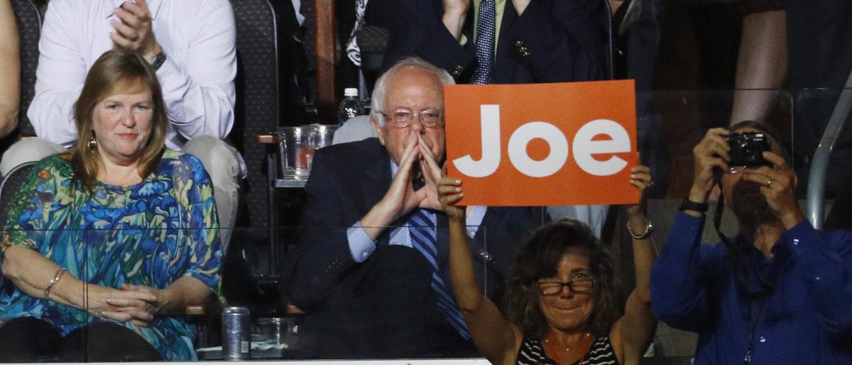 Sen. Bernie Sanders listens to Vice President Joe Biden at the Democratic National Convention in Philadelphia, Pennsylvania, U.S. July 27, 2016. REUTERS/Scott Audette