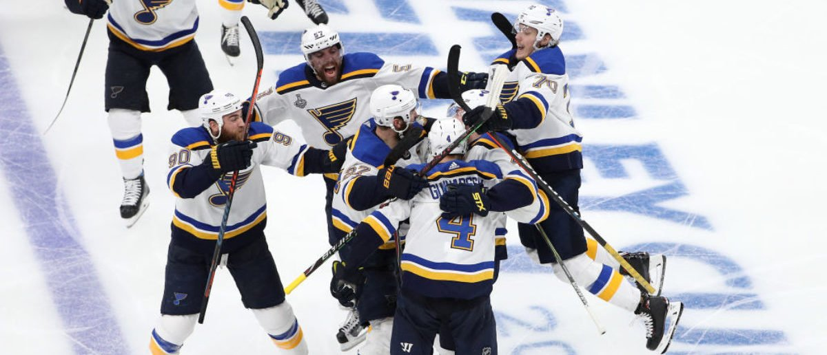 BOSTON, MASSACHUSETTS - MAY 29: Carl Gunnarsson #4 of the St. Louis Blues is congratulated by his teammates after scoring the game-winning goal during the first overtime period to defeat the Boston Bruins 3-2 in Game Two of the 2019 NHL Stanley Cup Final at TD Garden on May 29, 2019 in Boston, Massachusetts. (Photo by Patrick Smith/Getty Images)
