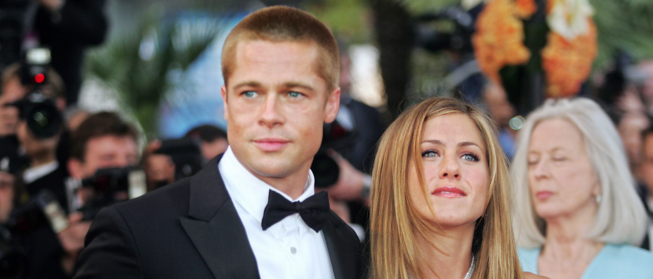 """US actor Brad Pitt and his wife Jennifer Aniston arrive for the official projection of US director Wolfgang Petersen's (5R) film """"Troy"""" , 13 May 2004, at the 57th Cannes Film Festival in the French Riviera town. Hollywood took over the French Riviera today as Brad Pitt and his co-stars of the epic movie arrived to present their 175 million dollar (147 million euro)-plus swords-and-sandals feature, being shown out of competition, in the blaze of Cannes publicity. (Photo credit BORIS HORVAT/AFP/Getty Images)"""