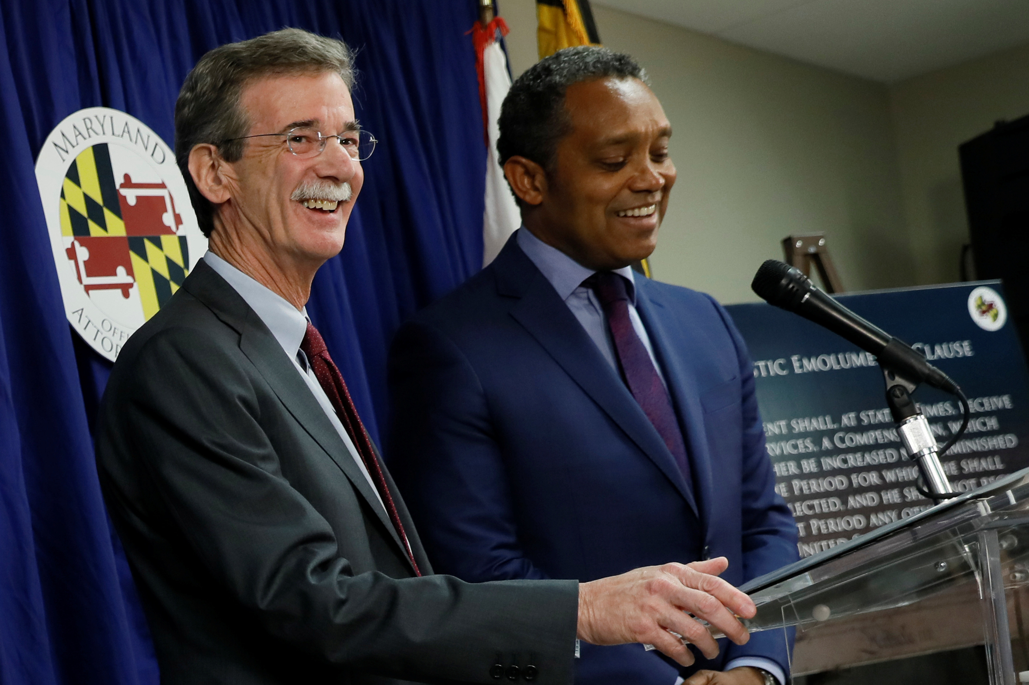 Maryland Attorney General Brian Frosh (L) and District of Columbia Attorney General Karl Racine hold a news conference to announce their lawsuit against U.S. President Donald Trump on the issue of the U.S. Constitution's emoluments clauses and Trump's business ventures, in Washington, DC, U.S. June 12, 2017. REUTERS/Jonathan Ernst