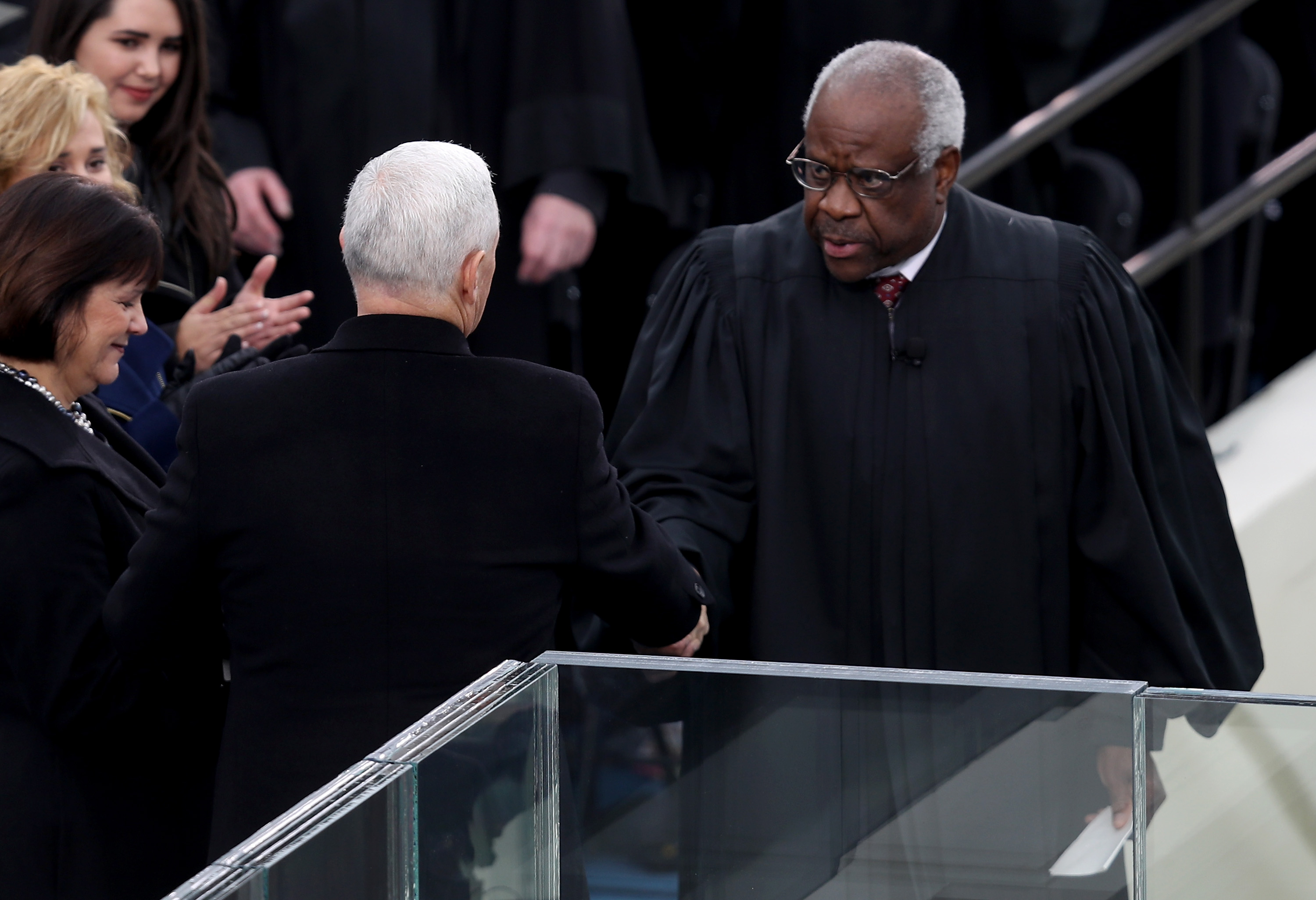 Vice President Mike Pence shakes hands with Justice Clarence Thomas on January 20, 2017. (Joe Raedle/Getty Images)