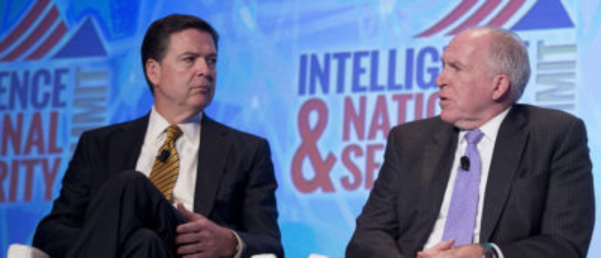 FBI Director James Comey (L) and CIA Director John Brennan speak at the 2016 Intelligence and National Security Summit in Washington, D.C., Sept. 8, 2016. / AFP / JIM WATSON (Photo credit should read JIM WATSON/AFP/Getty Images)