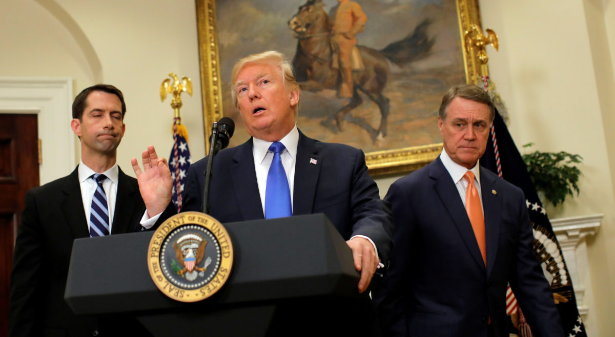 U.S. President Donald Trump speaks during an announcement on immigration reform accompanied by Senator Tom Cotton and Senator David Perdue, in the Roosevelt Room of the White House in Washington, U.S.