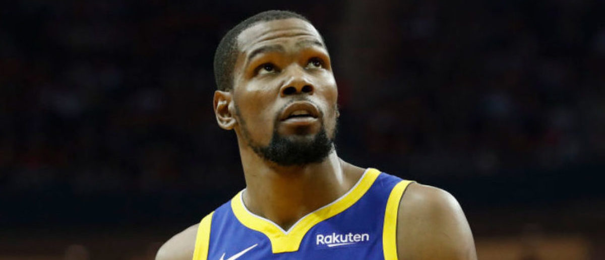 HOUSTON, TX - MAY 04: Kevin Durant #35 of the Golden State Warriors looks toward the scoreboard in the second quarter during Game Three of the Second Round of the 2019 NBA Western Conference Playoffs against the Houston Rockets at Toyota Center on May 4, 2019 in Houston, Texas. (Photo by Tim Warner/Getty Images)
