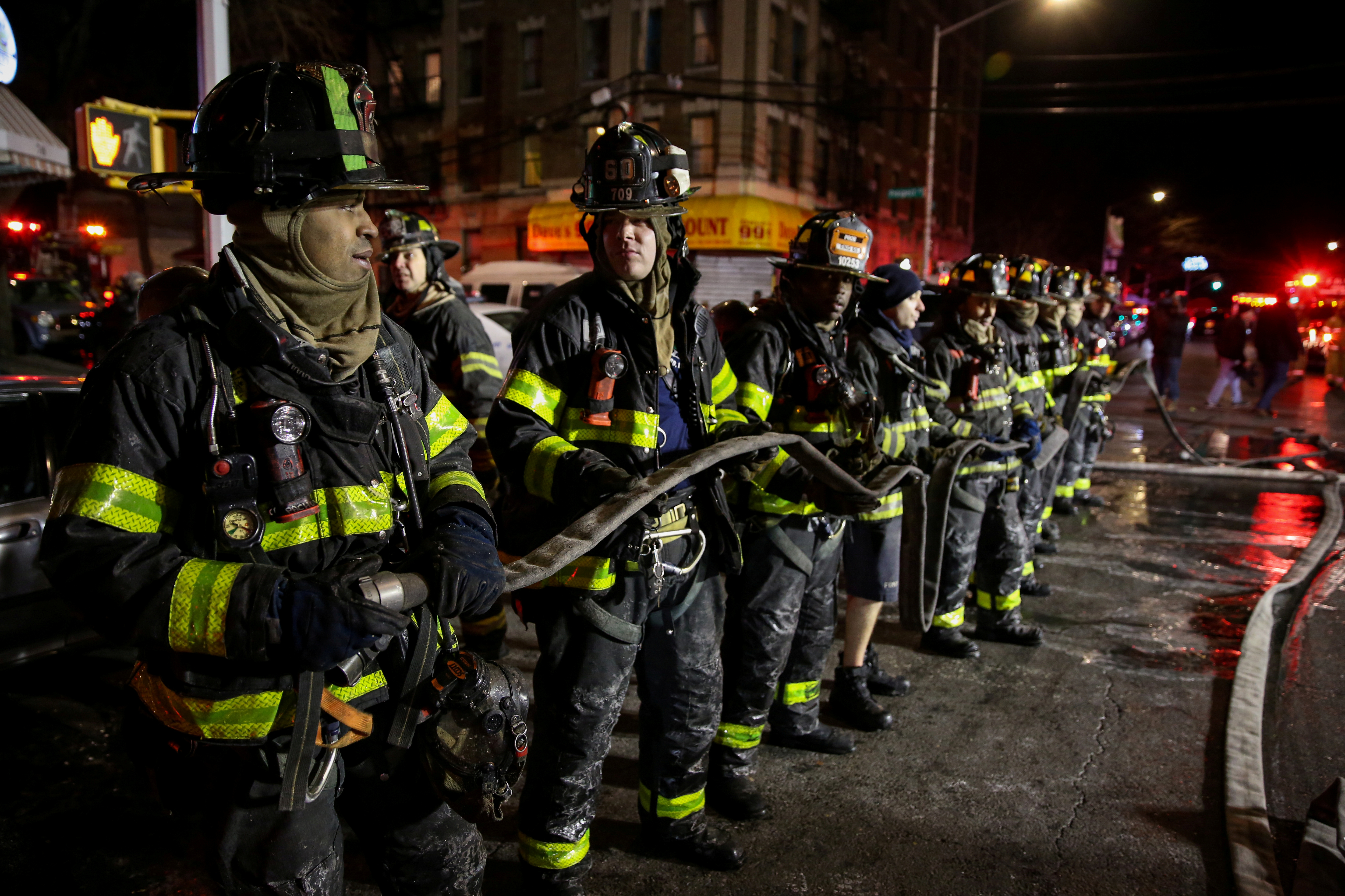 Fire Department of New York (FDNY) personnel work on the scene of an apartment fire in Bronx, New York, U.S. December 28, 2017. REUTERS/Amr Alfiky