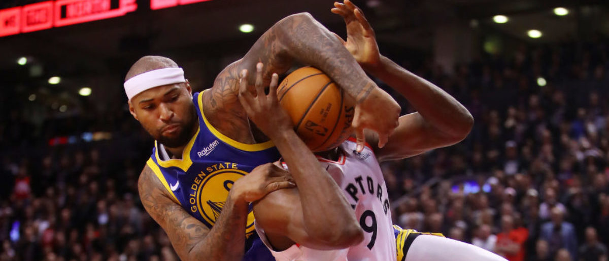 TORONTO, ONTARIO - MAY 30: DeMarcus Cousins #0 of the Golden State Warriors attempts to block a shot from Serge Ibaka #9 of the Toronto Raptors in the second half during Game One of the 2019 NBA Finals at Scotiabank Arena on May 30, 2019 in Toronto, Canada. (Photo by Gregory Shamus/Getty Images)