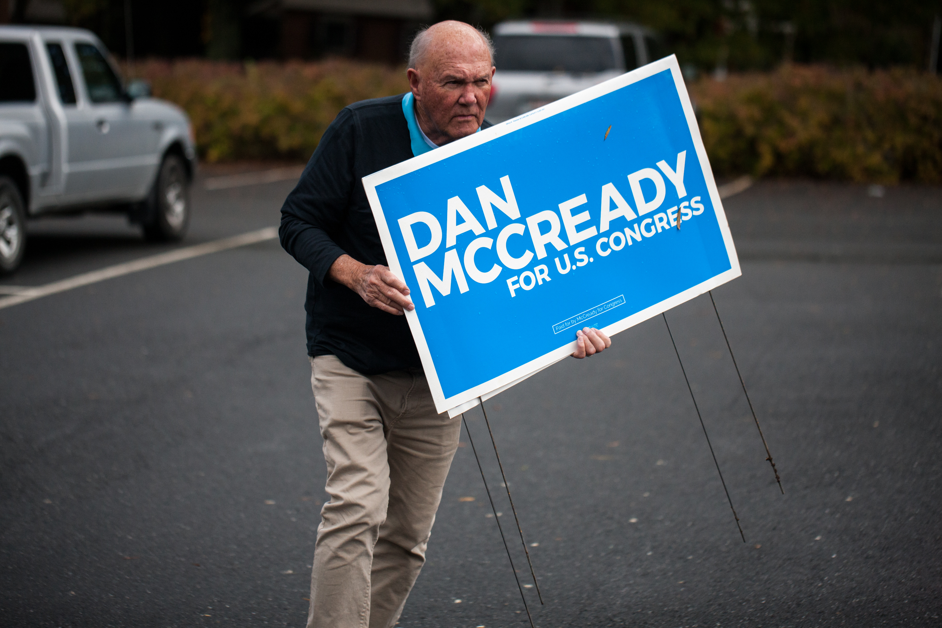 A campaign volunteer for Democratic US House candidate, Dan McCready, carries signs on November 6, 2018 in Charlotte, North Carolina. (LOGAN CYRUS/AFP/Getty Images)