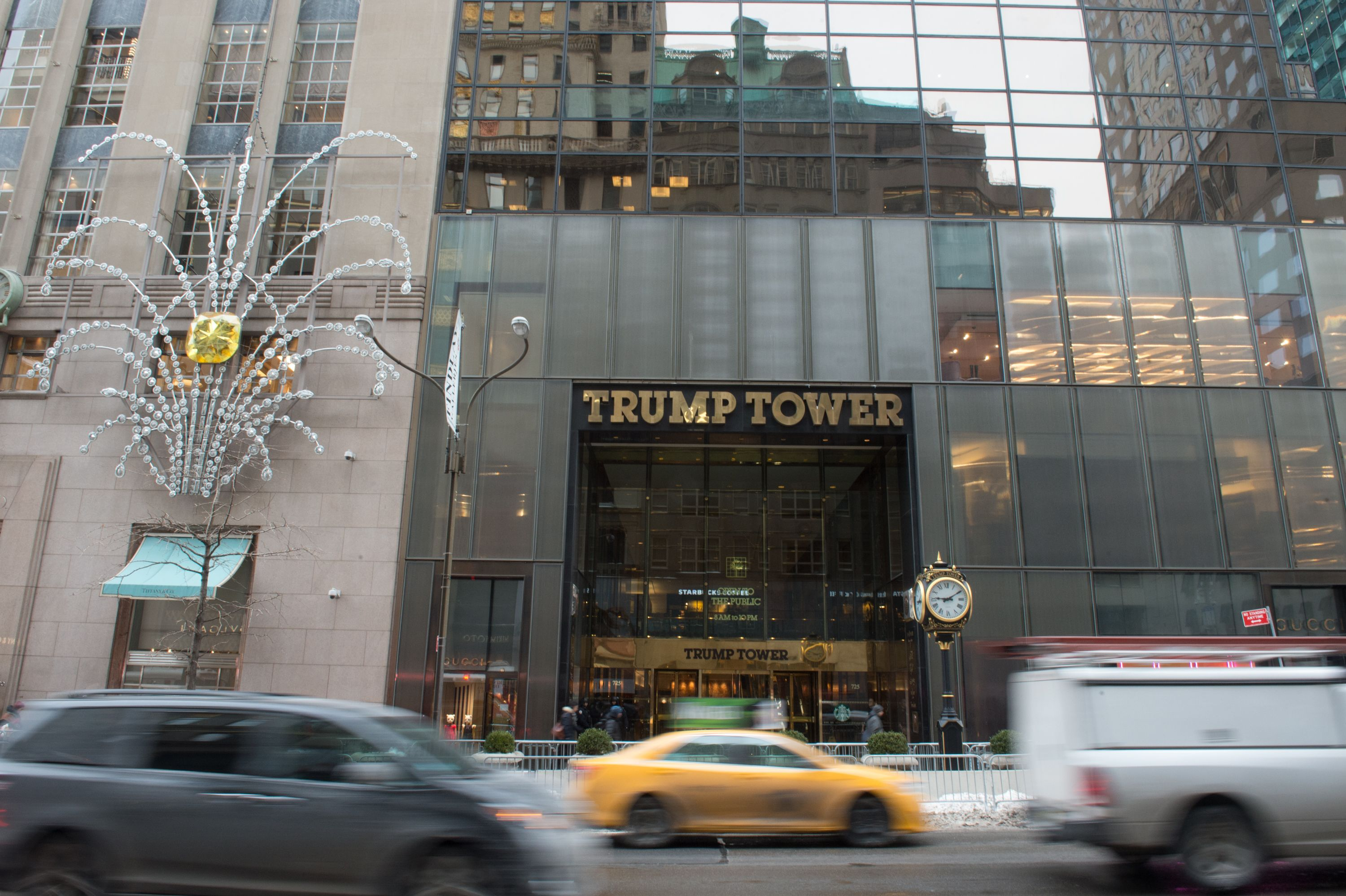 In this file photo taken on January 8, 2018, Cars drive past the front of Trump Tower on Fifth Avenue in New York. (BRYAN R. SMITH/AFP/Getty Images)