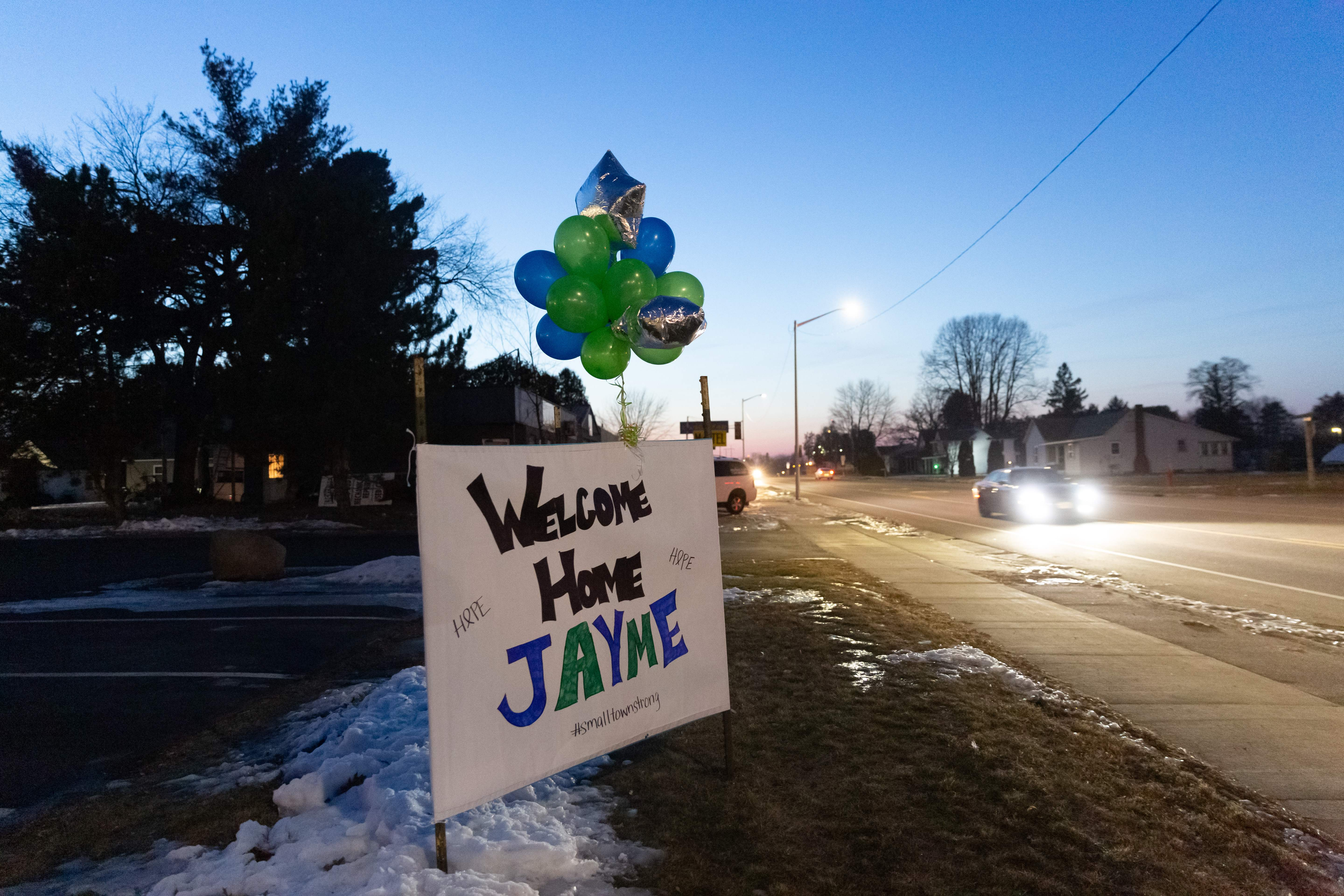 """A """"Welcome Home Jayme"""" sign displayed for Jayme Closs on January 11, 2019 in Barron, Wisconsin, one day after the missing teenager was found coming out of nearby woods. (KEREM YUCEL/AFP/Getty Images)"""