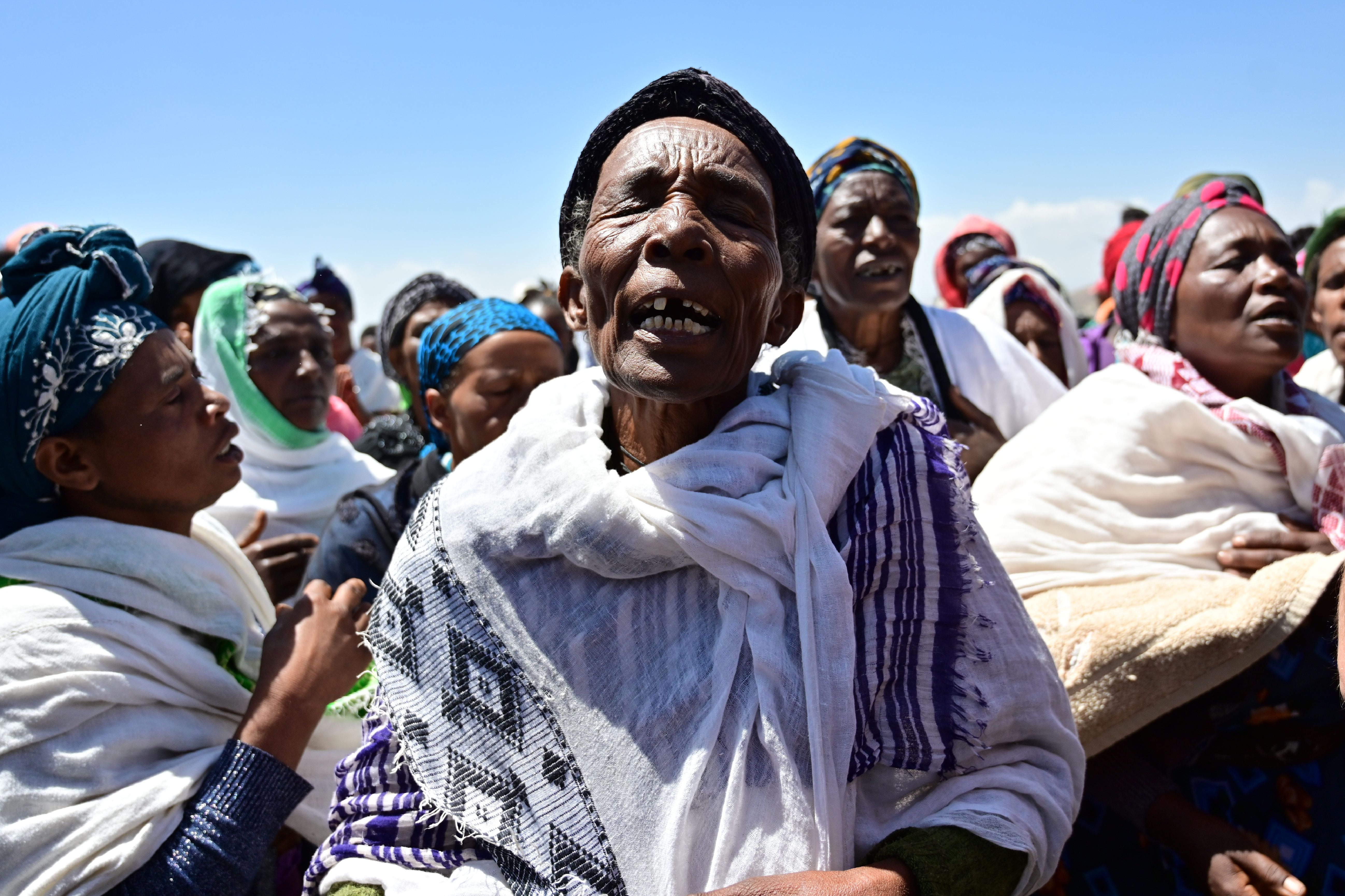 Oromo women perform a traditional chant at the crash site of the Ethiopian Airlines operated Boeing 737 MAX aircraft which killed 157 passengers and crew onboard, at Hama Quntushele village, near Bishoftu, in Oromia region, on March 15, 2019. (TONY KARUMBA/AFP/Getty Images)