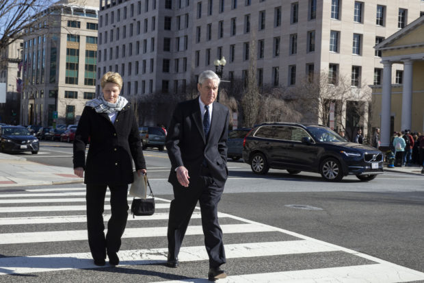 Ann Mueller and Special Counsel Robert Mueller walk