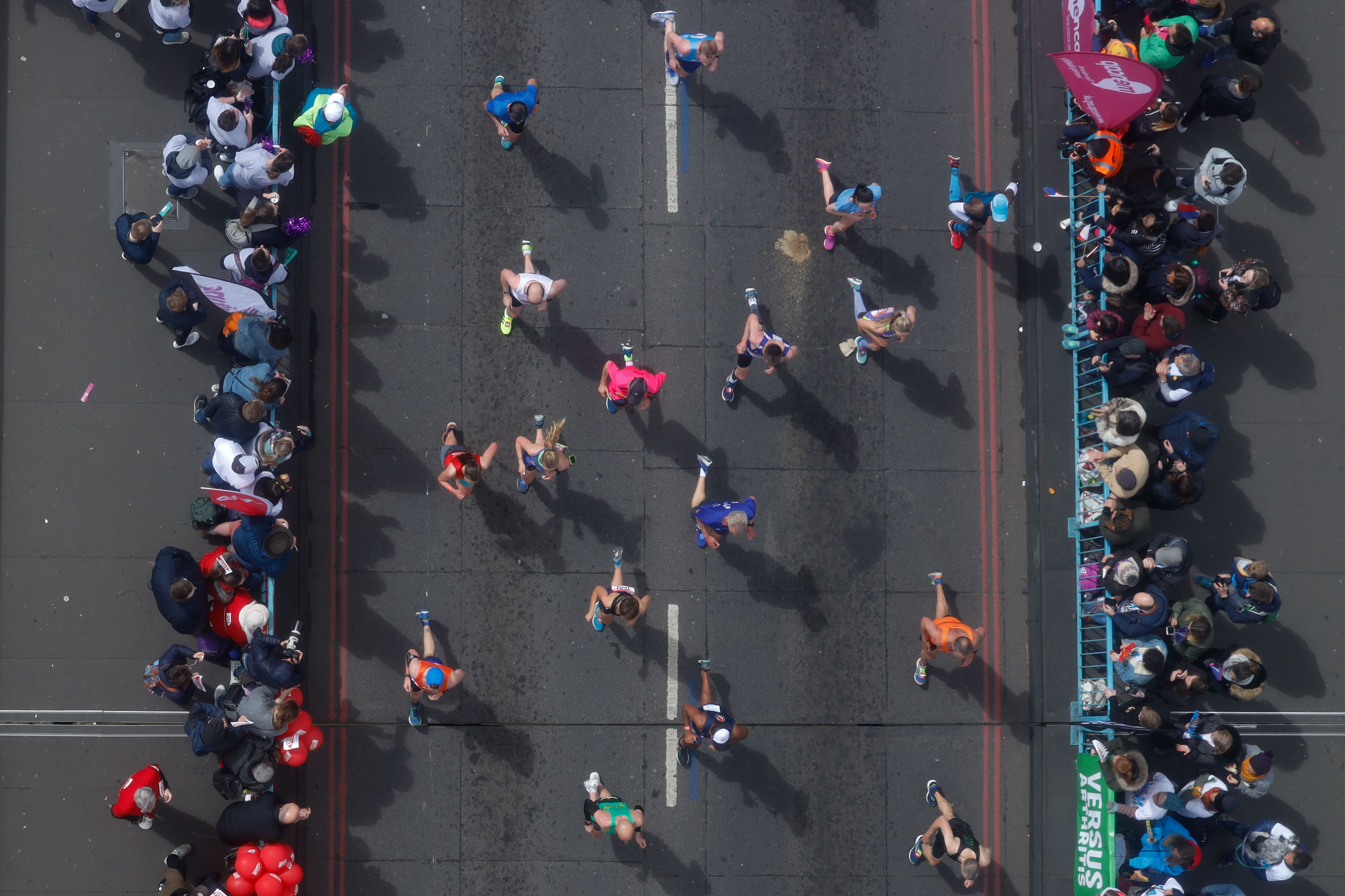 TOPSHOT - Competitors run across Tower Bridge as they compete in the 2019 London Marathon in central London on April 28, 2019. (TOLGA AKMEN/AFP/Getty Images)