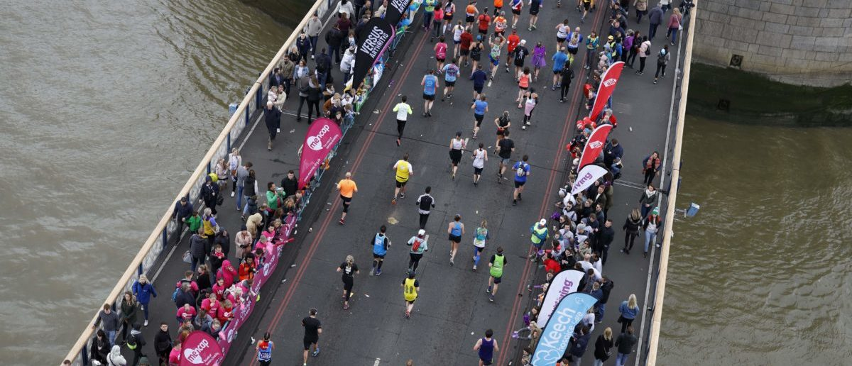 Competitors run across Tower Bridge as they compete in the 2019 London Marathon in central London on April 28, 2019. (TOLGA AKMEN/AFP/Getty Images)