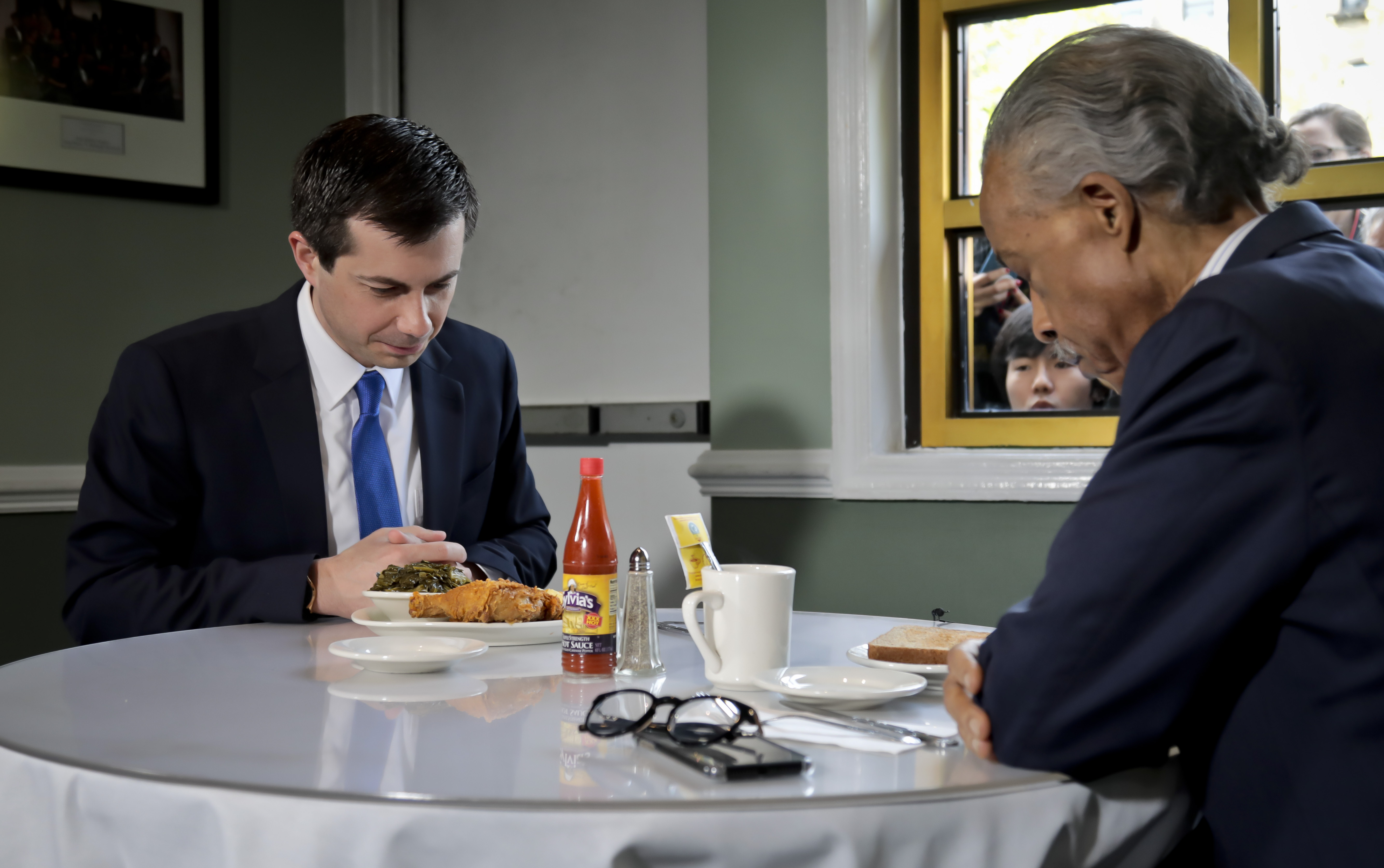 Democratic presidential candidate Mayor Pete Buttigieg (L) of South Bend, Indiana and civil rights leader Rev. Al Sharpton (R), President of National Action Network, hold a lunch meeting at Sylvias Restaurant in Harlem, New York, Monday, April 29, 2019. (Photo by Bebeto Matthews / POOL / AFP) (Photo credit should read BEBETO MATTHEWS/AFP/Getty Images)