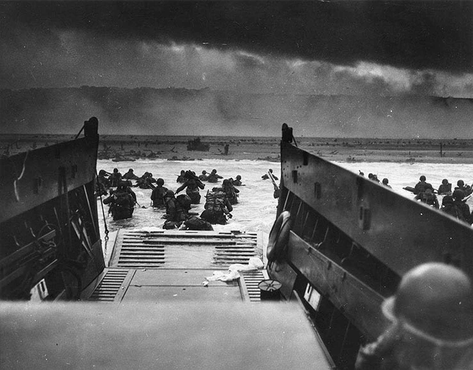 This photograph from the National Archives taken on June 6, 1944, shows US Army troops wading ashore at Omaha Beach in north-western France, during the D-Day invasion. (Photo by STF/AFP/Getty Images)