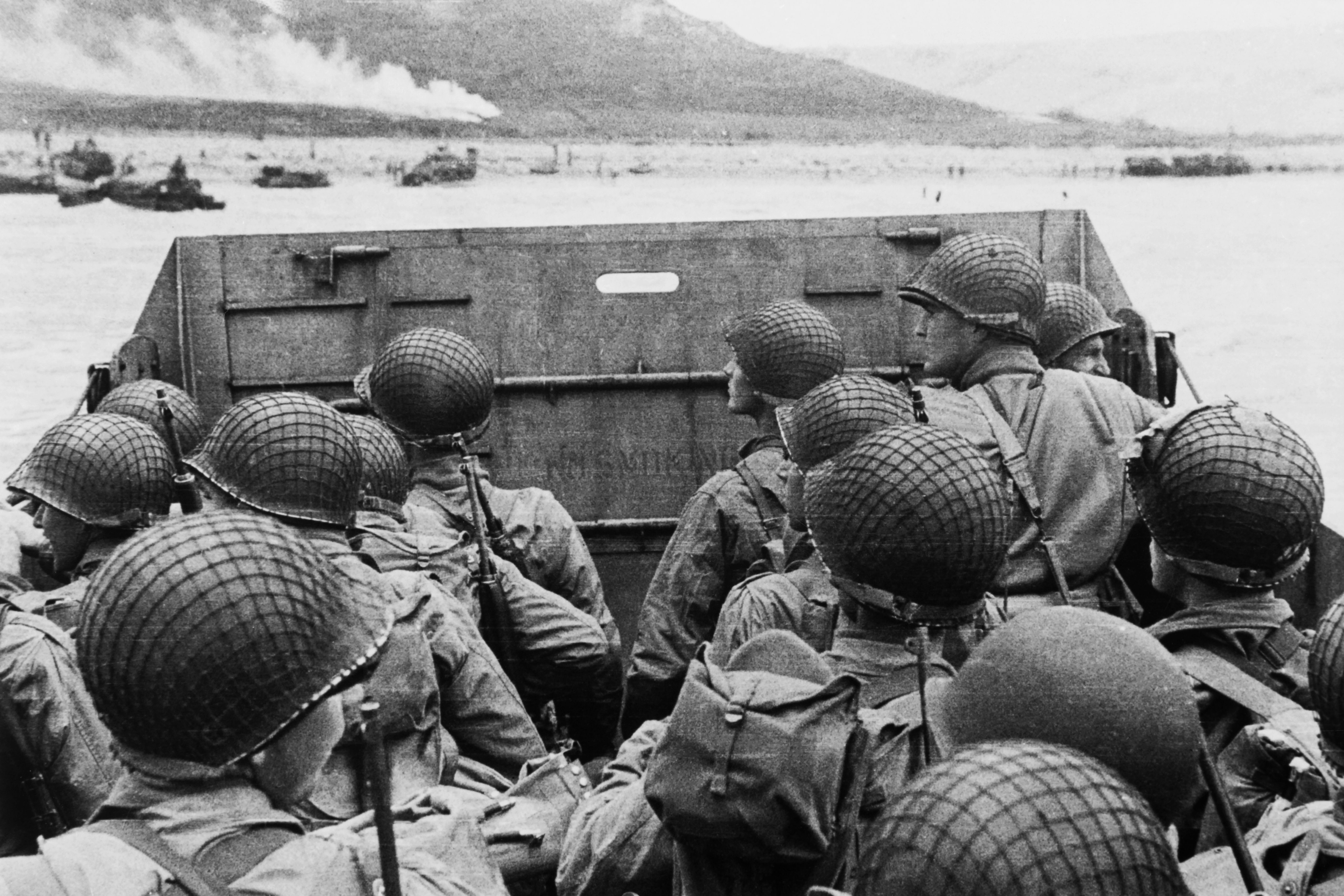American assault troops in a landing craft huddle behind the shield 06 June 1944 approaching Utah Beach while Allied forces are storming the Normandy beaches on D-Day. (Photo by US Army Photo/AFP/Getty Images)