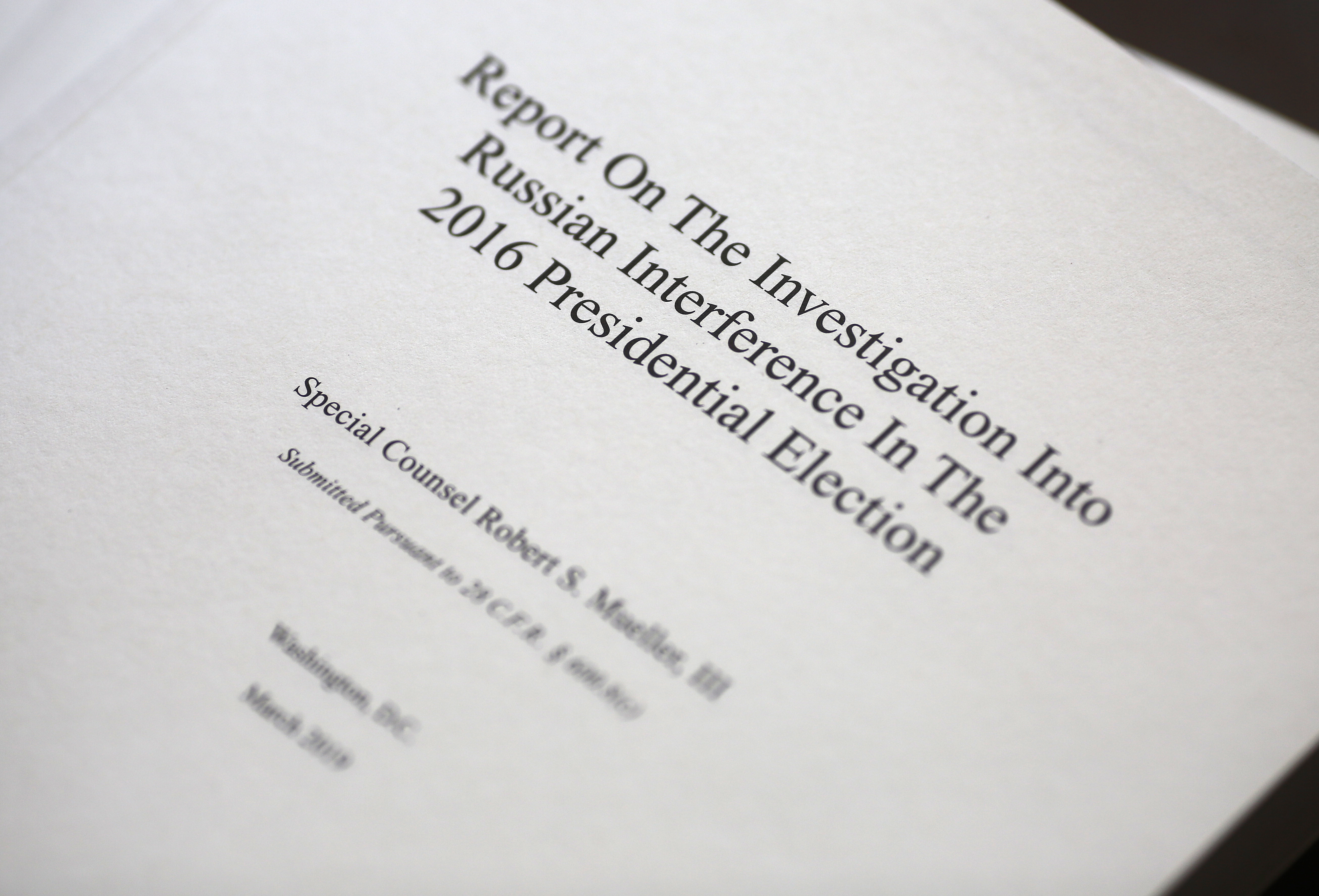 """WASHINGTON, DC - APRIL 24: The cover of the recently released Mueller Report is shown April 24, 2019 in Washington, DC. In response to news from then Attorney General Jeff Sessions that Robert Mueller had been appointed as a Special Counsel to investigate allegations of Russian interference in the 2016 U.S. presidential election, U.S. President Donald Trump said """"Oh my God. This is terrible. This is the end of my presidency."""" (Photo by Win McNamee/Getty Images)"""
