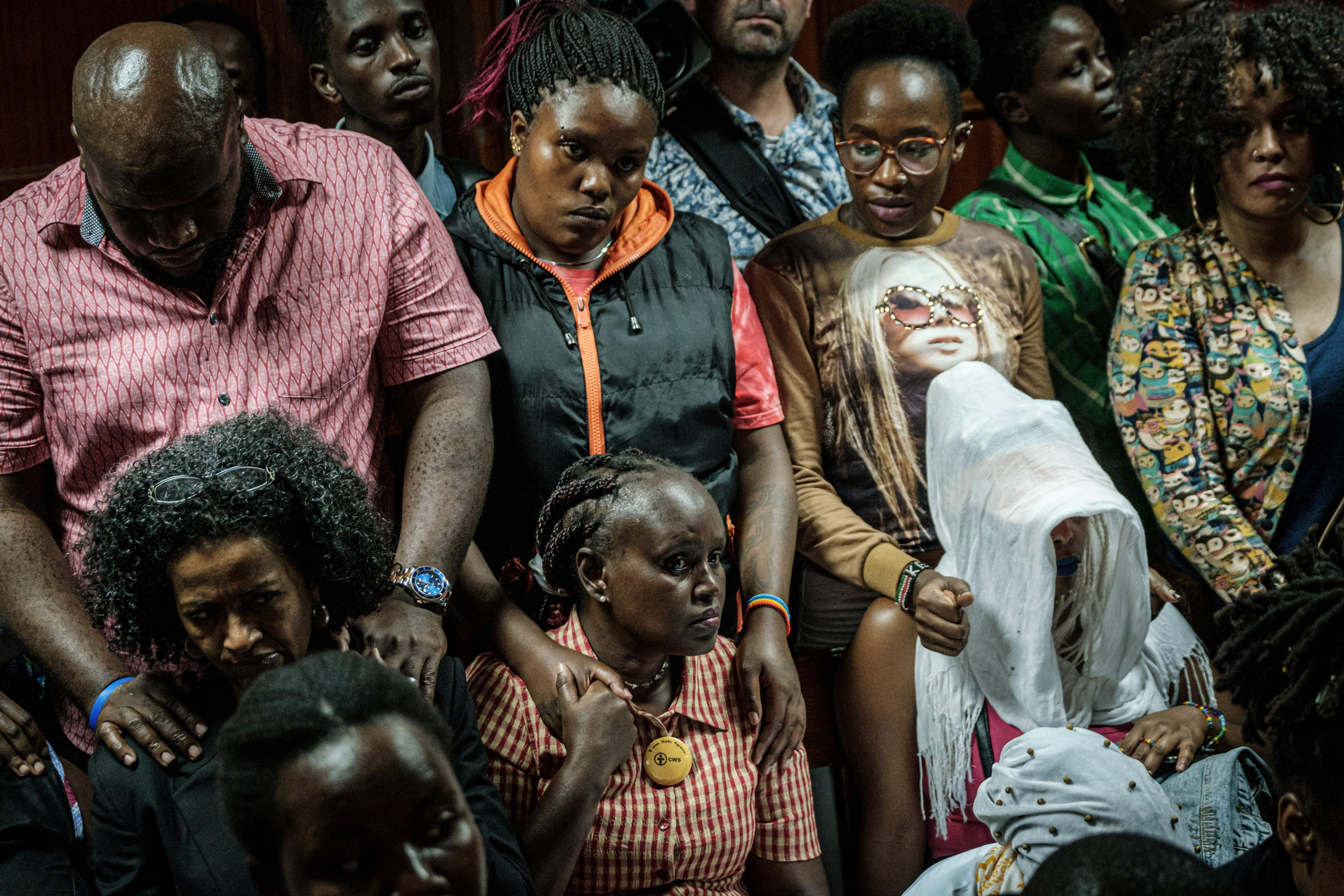 LGBTQ community members and supporters listen to a verdict on scrapping laws criminalising homosexuality at the Milimani high court in Nairobi, Kenya, on May 24, 2019. (YASUYOSHI CHIBA/AFP/Getty Images)