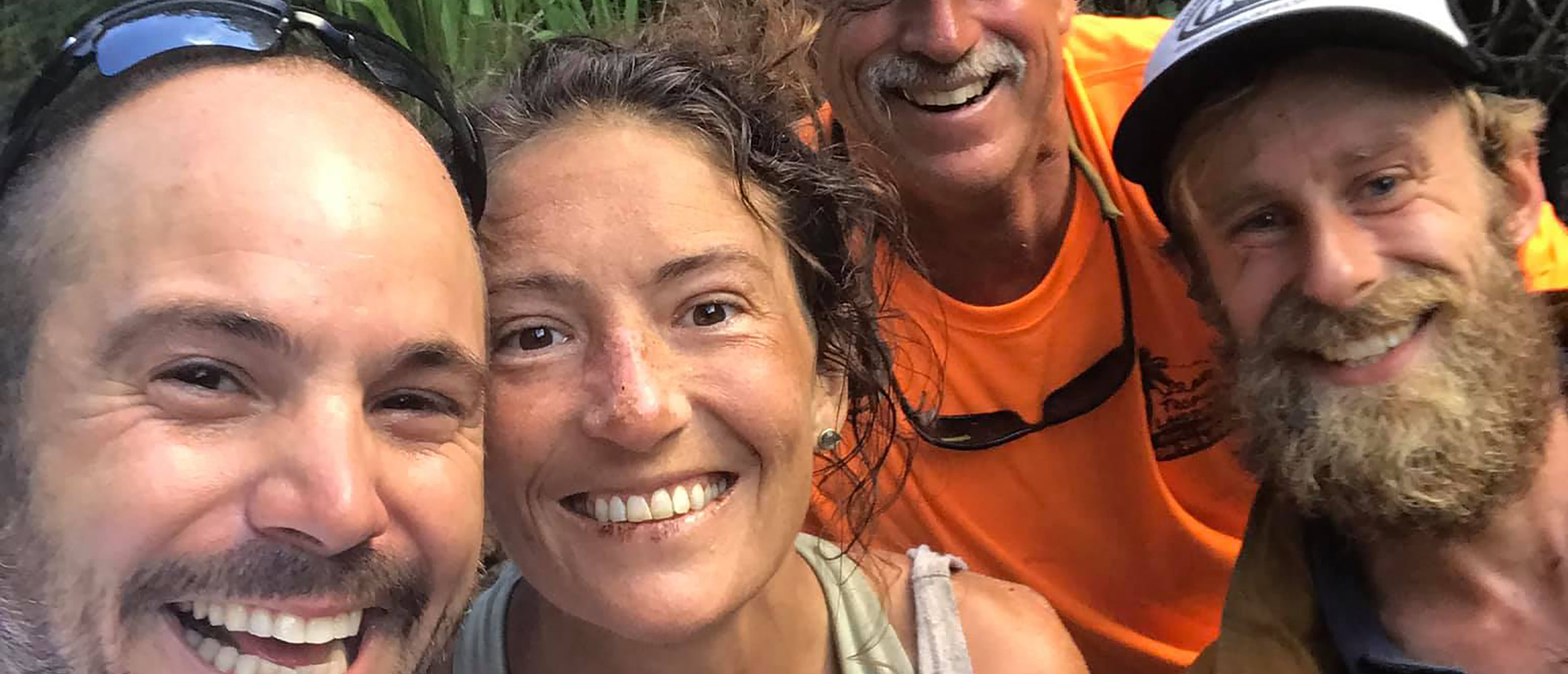 This image courtesy of Javier Cantellops and obtained at facebook.com/AmandaEllersMissing/, shows missing hiker Amanda Eller (2nd L) with her rescuers, (L-R) Javier Cantellops, Troy Helmer and Chris Berquist, on May 24, 2019, at Makawao Forest Reserve on the Hawaiian Island of Maui. (JAVIER CANTELLOPS/AFP/Getty Images)