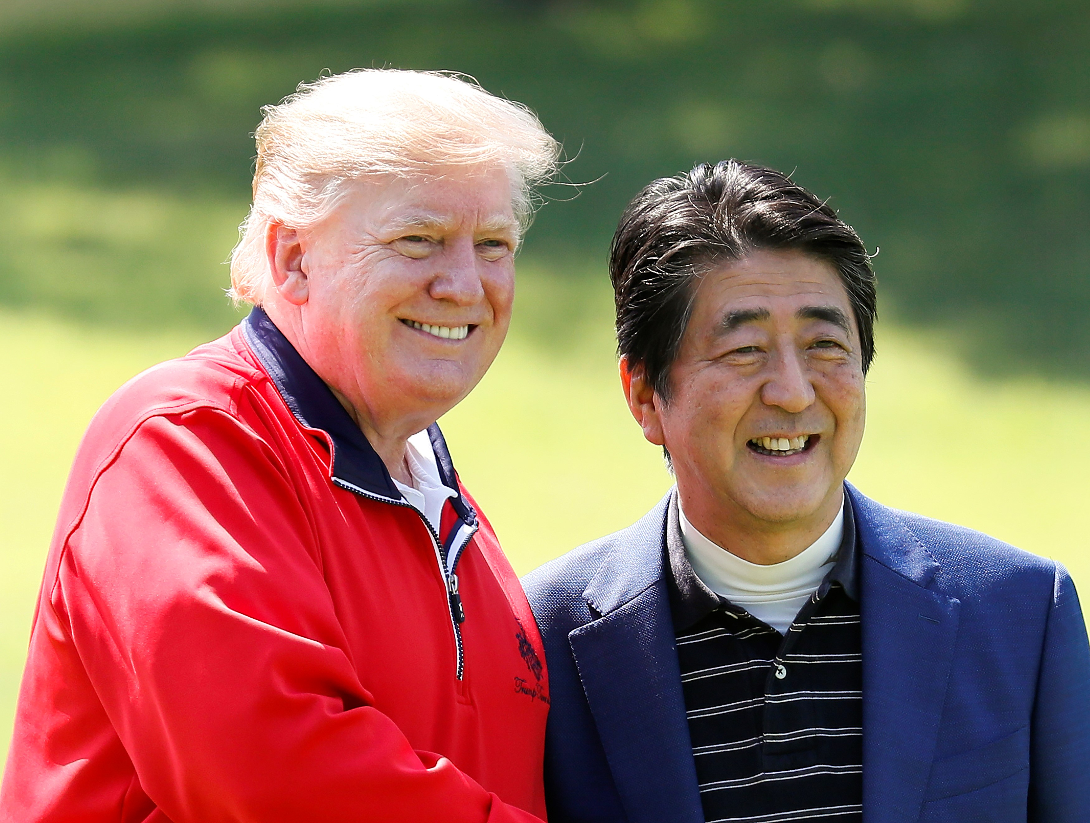 TOPSHOT - Japan's Prime Minister Shinzo Abe (R) and US President Donald Trump smile before playing a round of golf at Mobara Country Club in Chiba on May 26, 2019. (Photo by KIMIMASA MAYAMA/AFP/Getty Images)