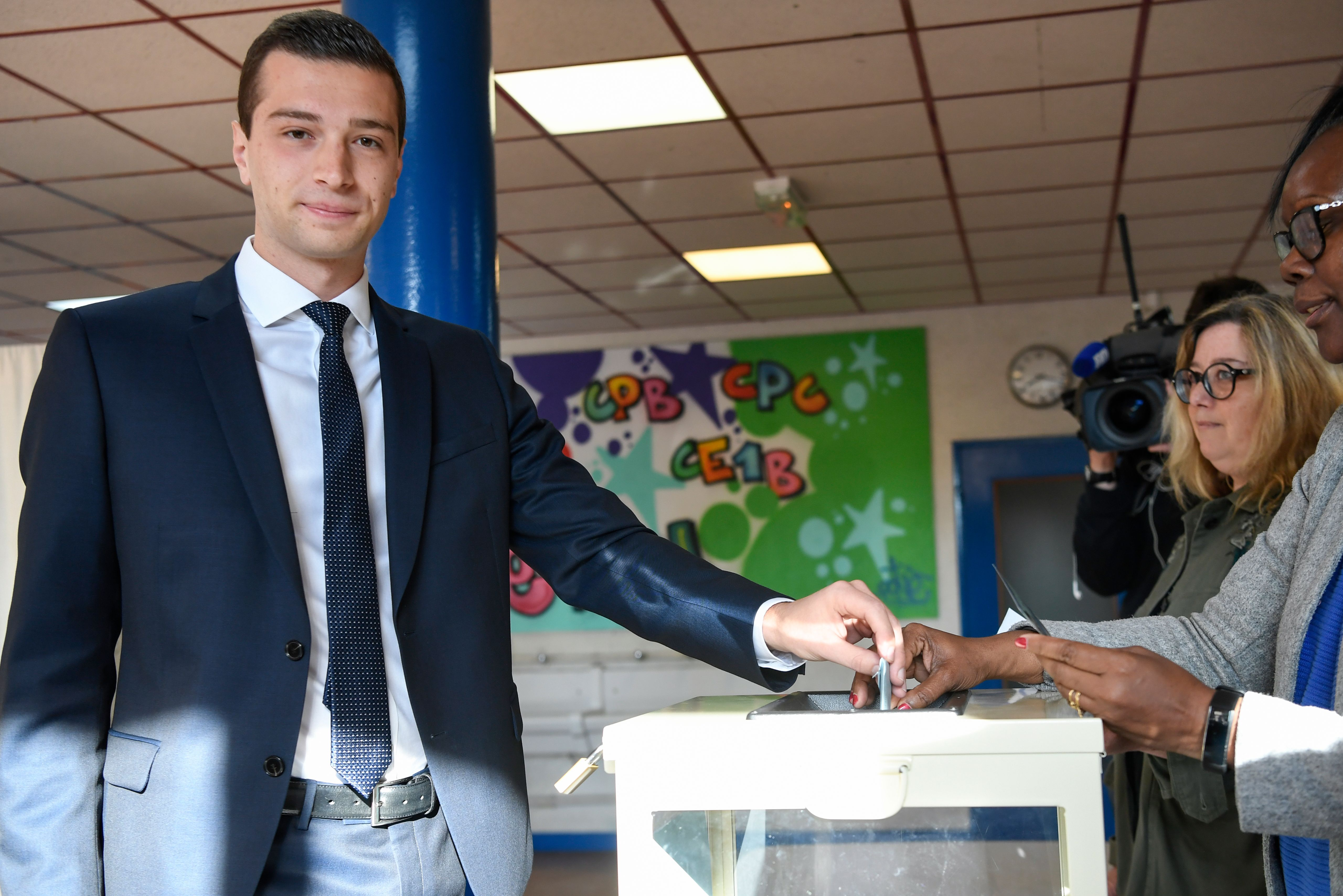 French far-right Rassemblement National (RN) party head candidate for European elections Jordan Bardella (L) casts his vote for the European elections at the Paul Langevin school polling station in Saint-Denis, north of Paris, on May 26, 2019. (BERTRAND GUAY/AFP/Getty Images)