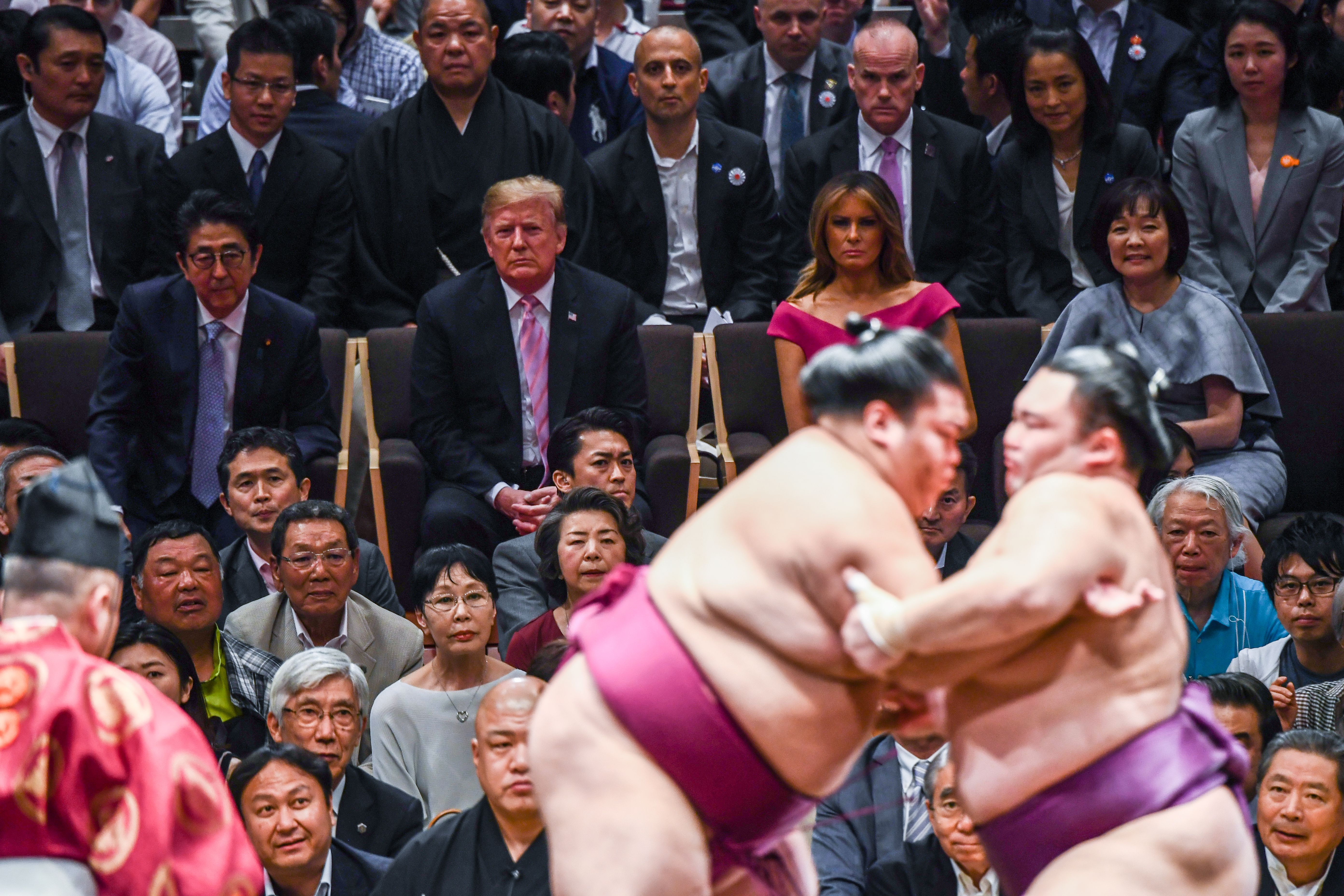US President Donald Trump and First Lady Melania Trump are accompanied by Japan's Prime Minister Shinzo Abe and his wife Akie Abe (centre row) as they watch a sumo battle during the Summer Grand Sumo Tournament in Tokyo on May 26, 2019. (Photo by BRENDAN SMIALOWSKI/AFP/Getty Images)